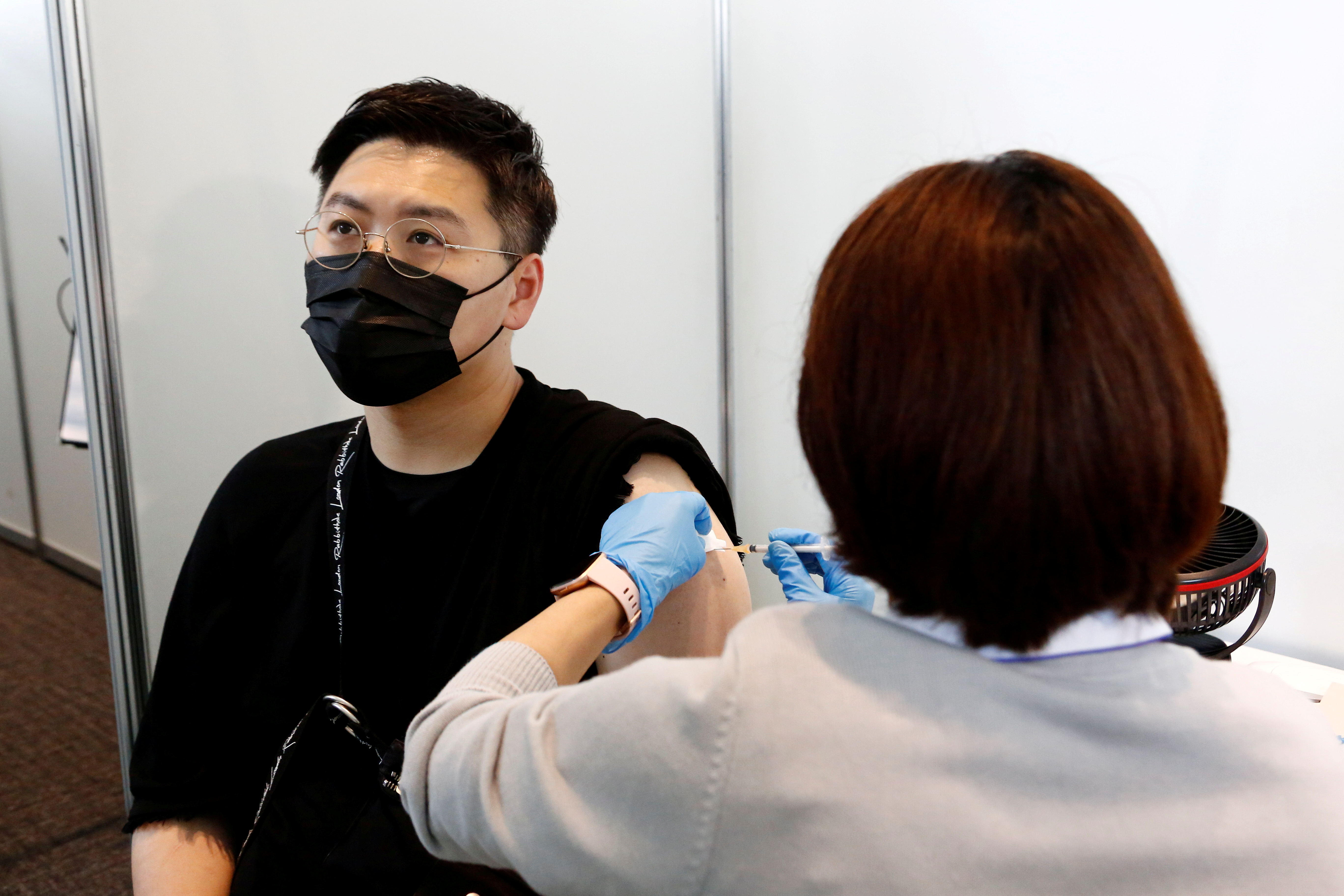 A man receives the Moderna coronavirus vaccine at the Tokyo Metropolitan Government building in Tokyo, Japan June 25, 2021. Rodrigo Reyes Marin/Pool via REUTERS