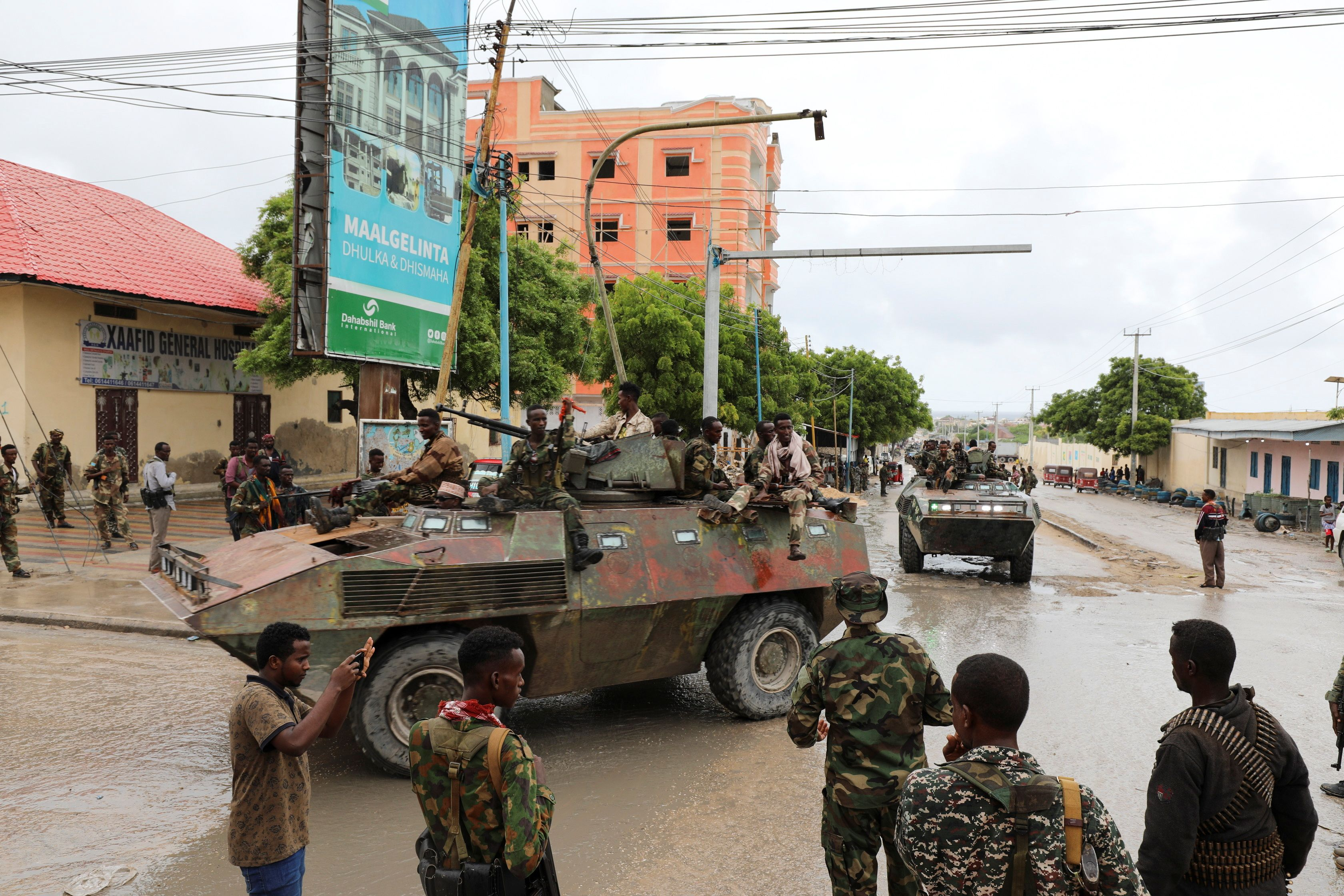 Members of Somali National Army (SNA), who back the opposition, prepare to move to their barracks after reaching an agreement with the prime minister following clashes over the tenure of the president, in Mogadishu, Somalia May 7, 2021. REUTERS/Feisal Omar