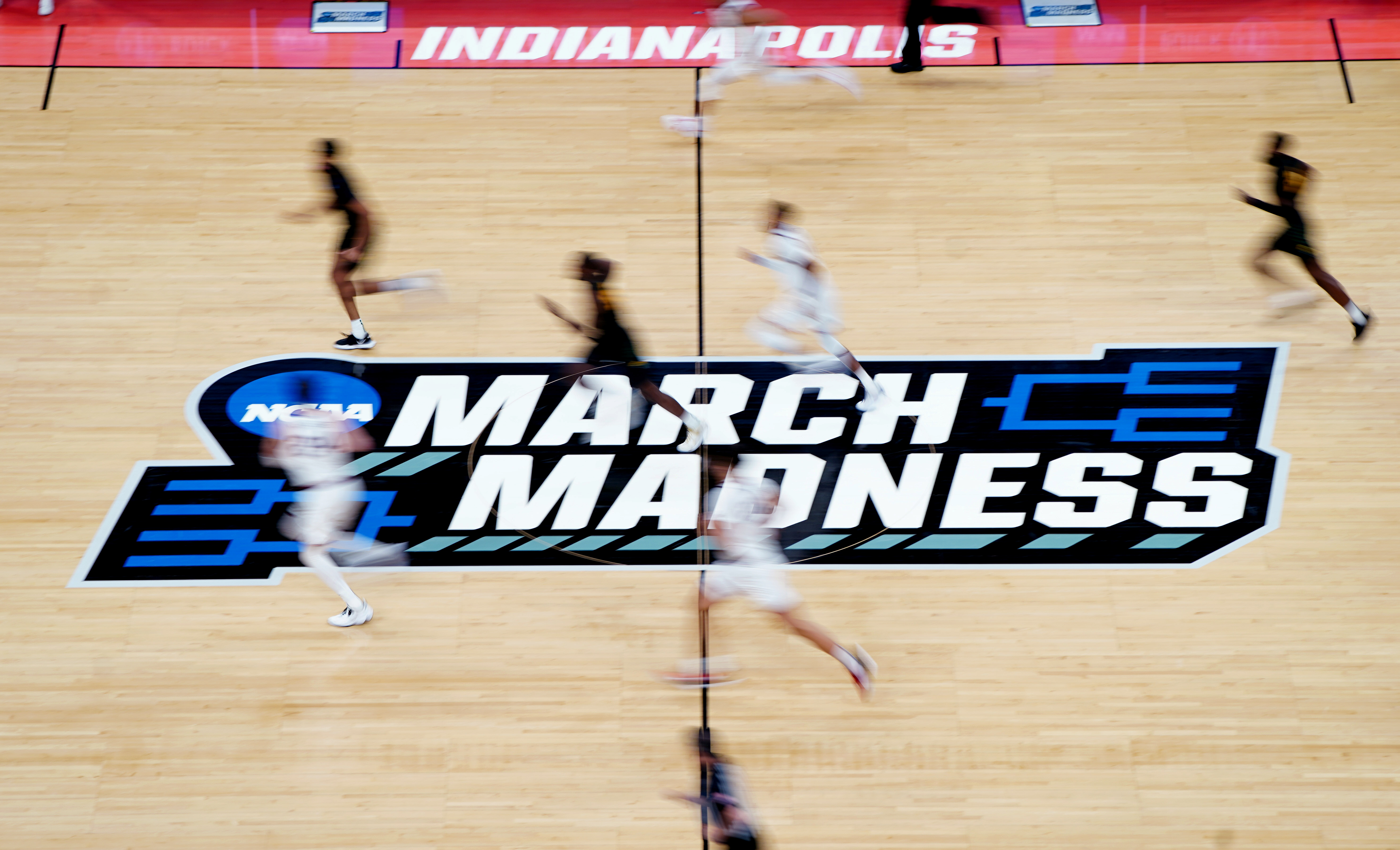 FILE PHOTO: A detailed view of the March Madness logo at center court as Gonzaga Bulldogs and Norfolk State Spartans players run by during the second half in the first round of the 2021 NCAA Tournament at Bankers Life Fieldhouse, Indianapolis, Indiana, March 20, 2021. Kirby Lee-USA TODAY Sports/File Photo