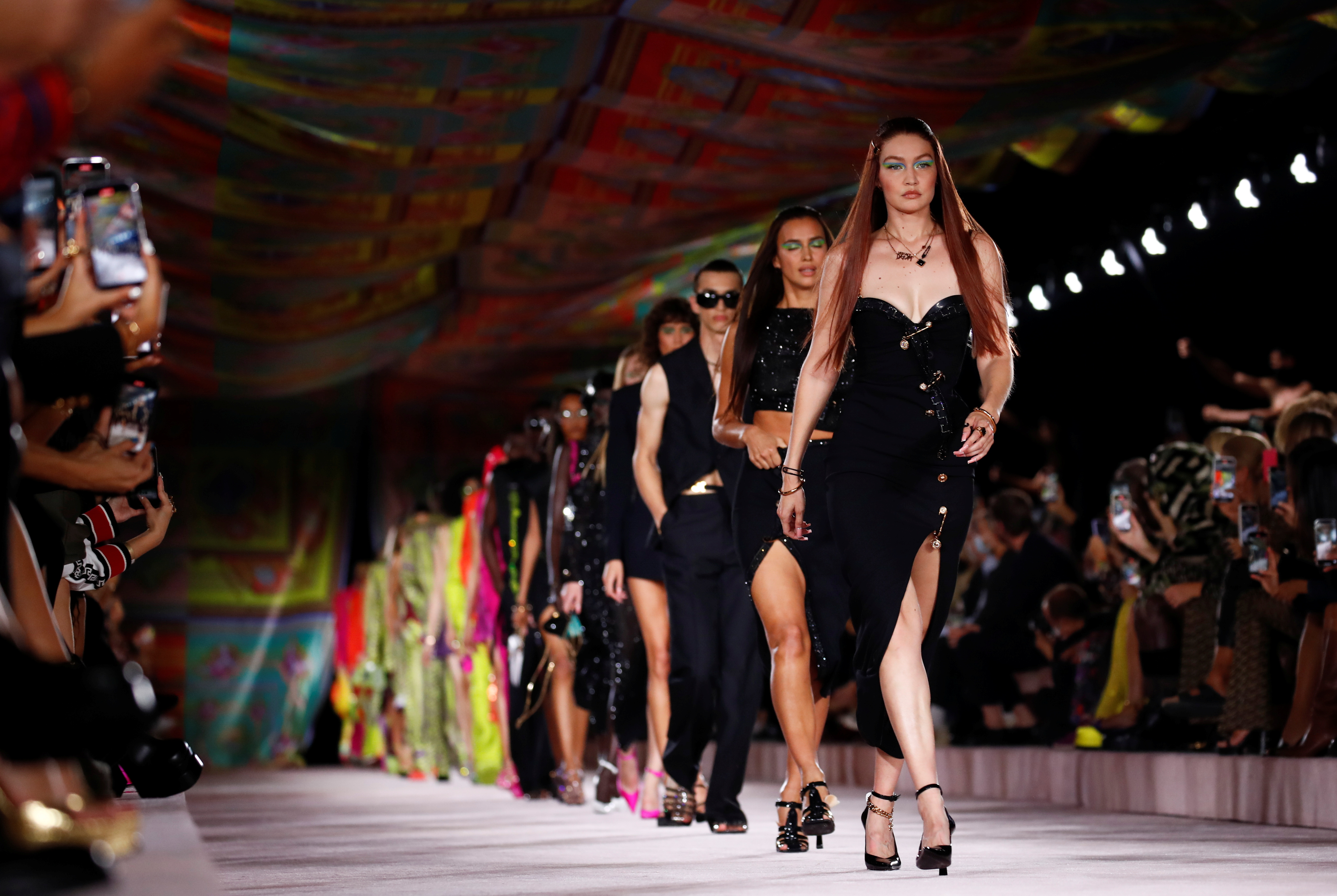 Gigi Hadid walks with models to present creations from the Versace Spring/Summer 2022 collection during Milan Fashion Week in Milan, Italy, September 24, 2021. REUTERS/Alessandro Garofalo