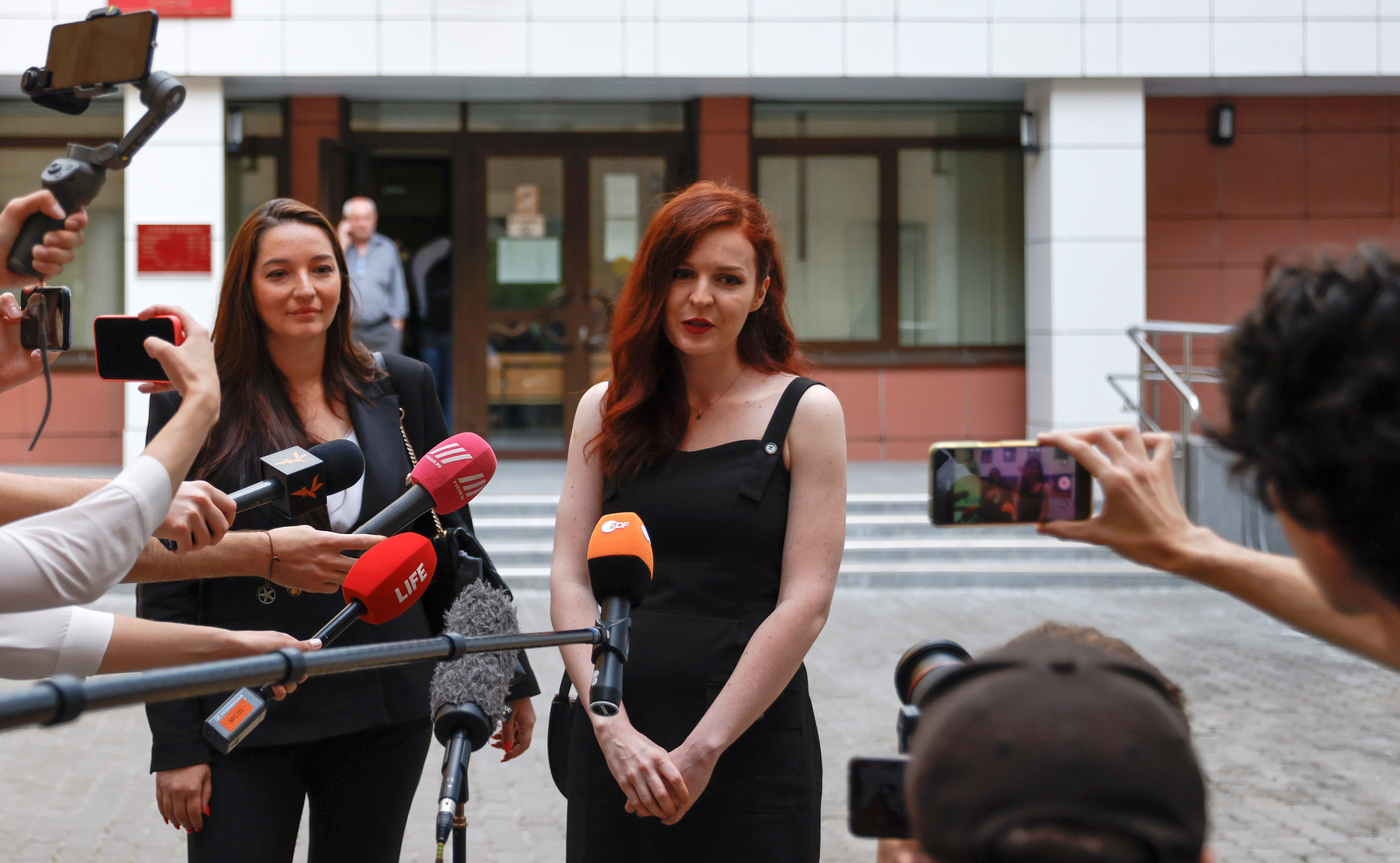 Kremlin critic Alexei Navalny's spokesperson Kira Yarmysh accused of breaching COVID-19 safety regulations speaks with journalists after a court hearing in Moscow, Russia August 16, 2021. REUTERS/Evgenia Novozhenina