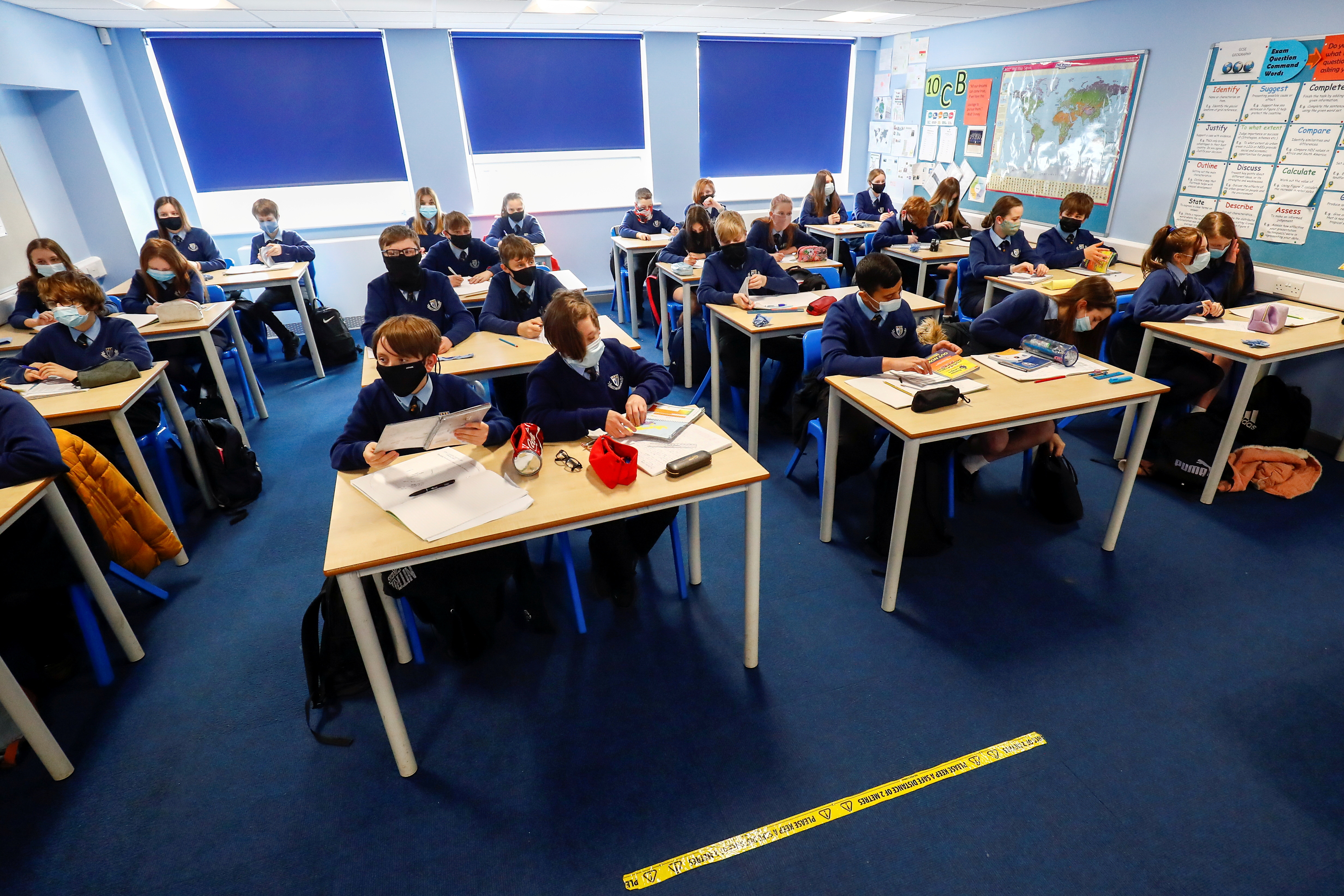Students attend a lesson at Weaverham High School, as the coronavirus disease (COVID-19) lockdown begins to ease, in Cheshire, Britain, March 9, 2021. REUTERS/Jason Cairnduff