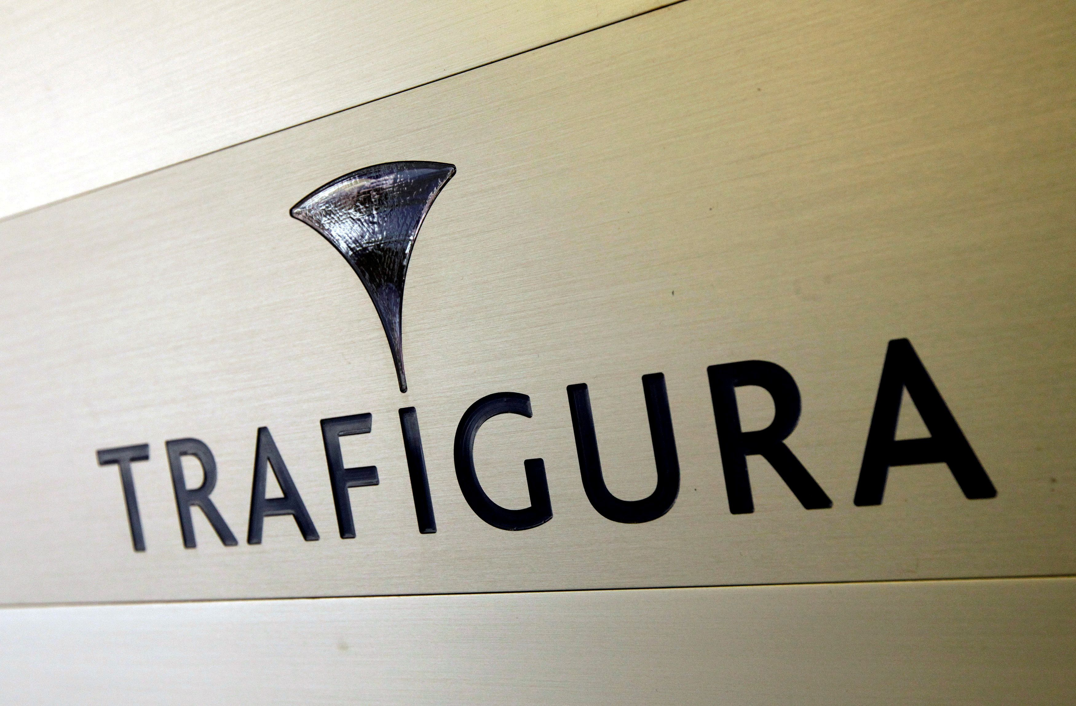 Trafigura logo is pictured in the company entrance in Geneva, Switzerland March 11, 2012. REUTERS/Denis Balibouse//File Photo