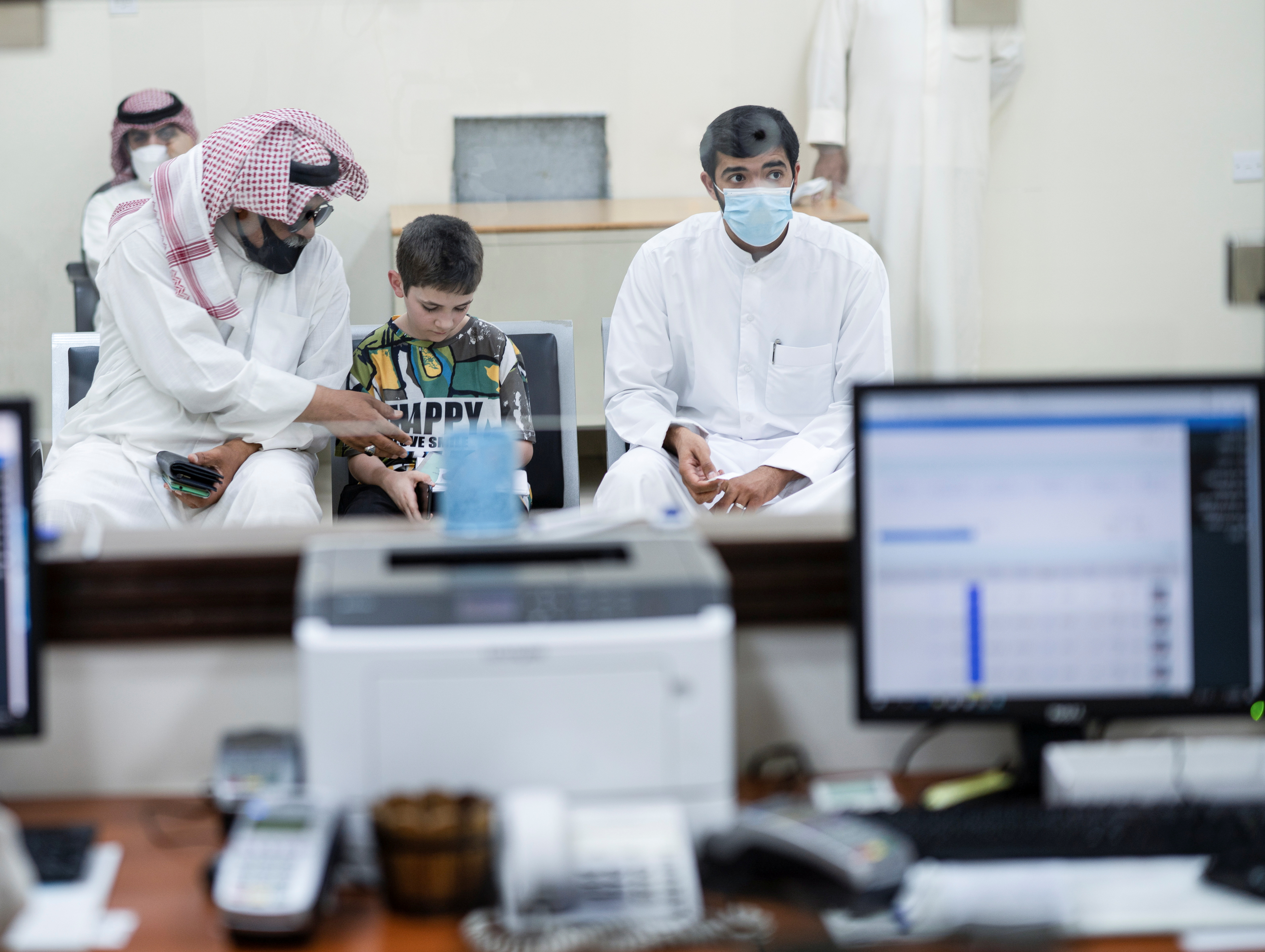 Stateless residents wait to get their Security Cards that are issued by the  Central Agency for Remedying Illegal Residents Status in Ardiya, Kuwait September 27, 2021. Picture taken September 27, 2021. REUTERS/Stephanie McGehee