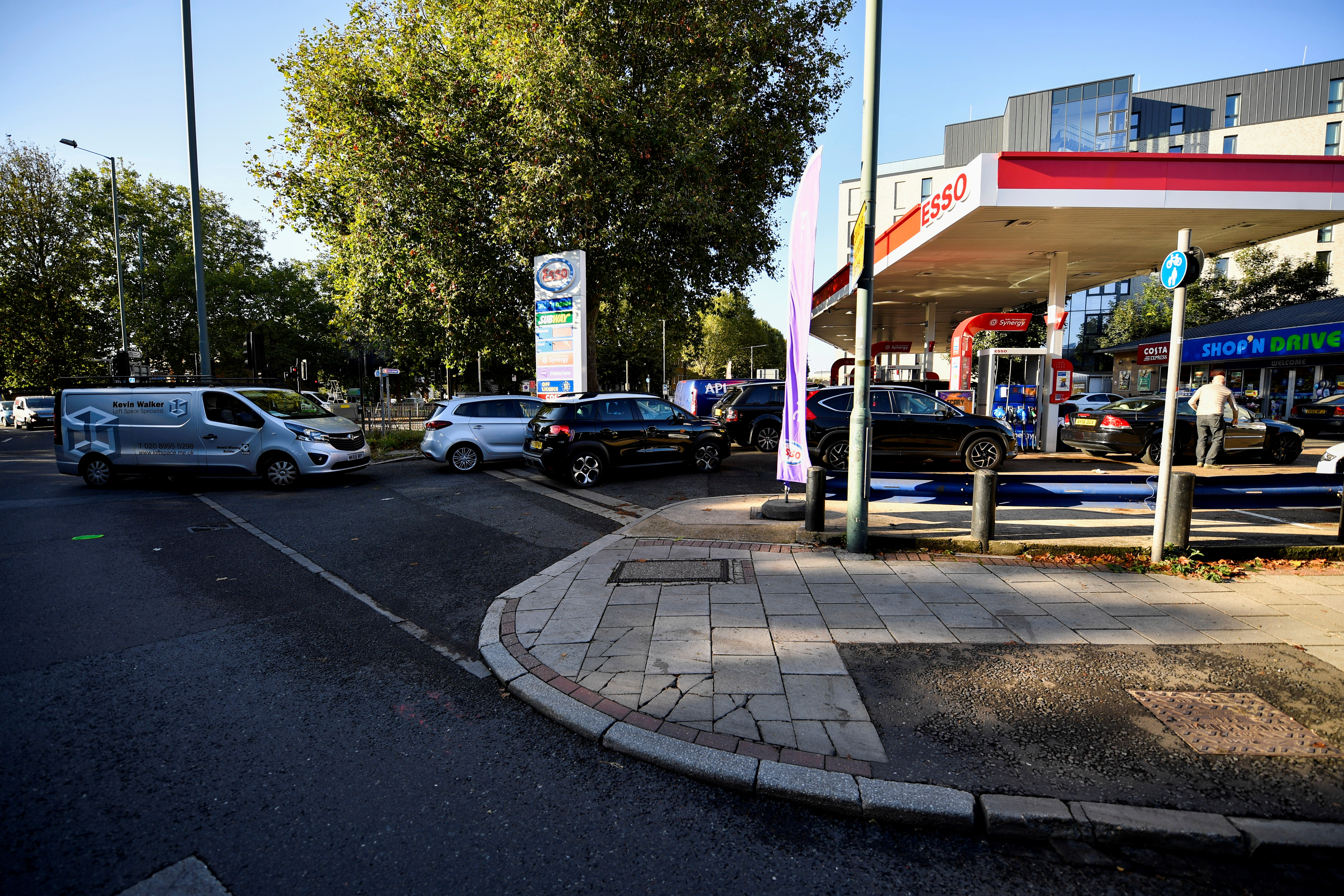 Drivers queue for petrol as panic buying continues in London, Britain,September 29, 2021. REUTERS/Beresford Hodge/File Photo