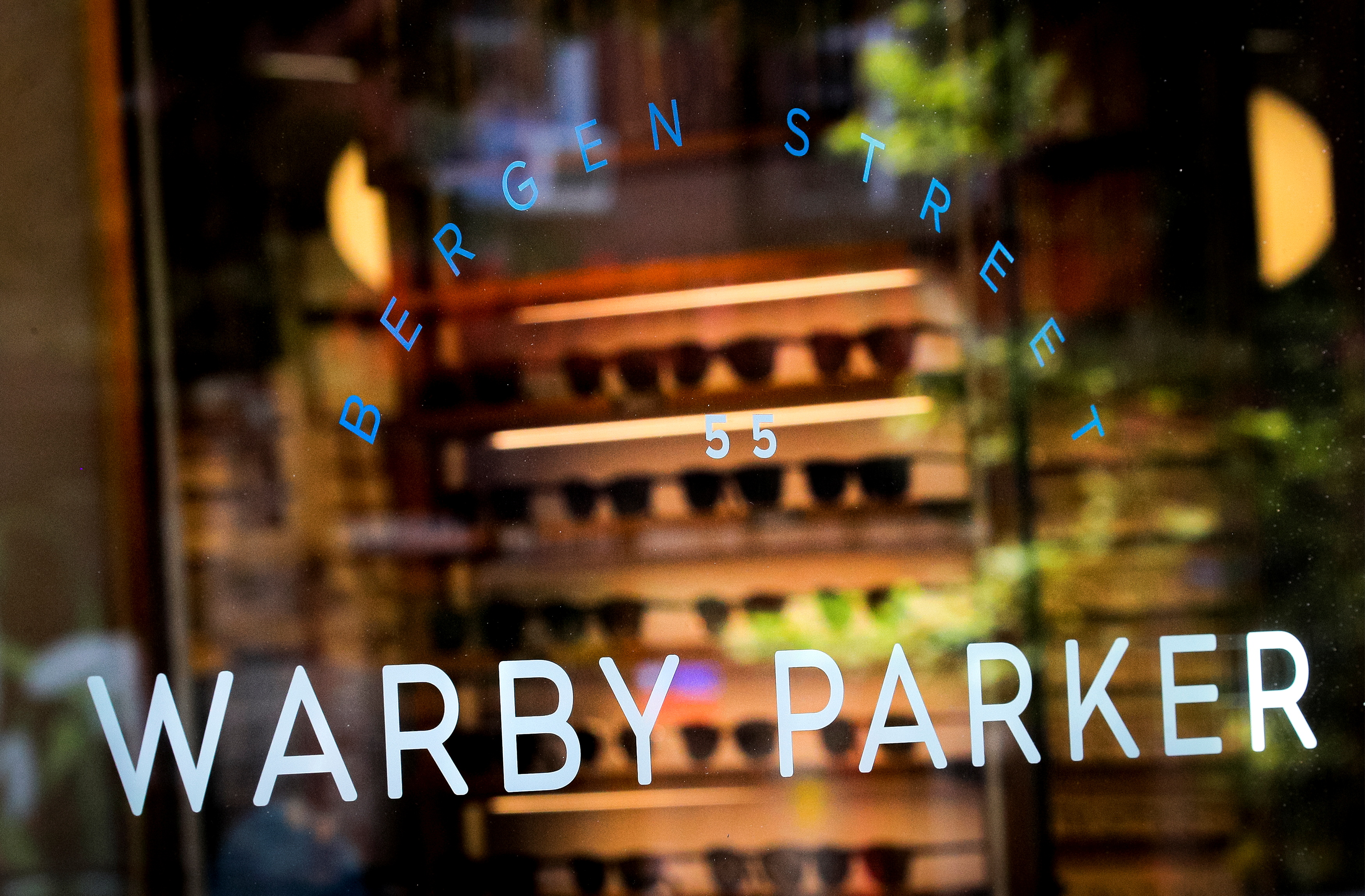 A sign is seen on the door of a Warby Parker store in Brooklyn, New York, U.S., June 24, 2021.  REUTERS/Brendan McDermid