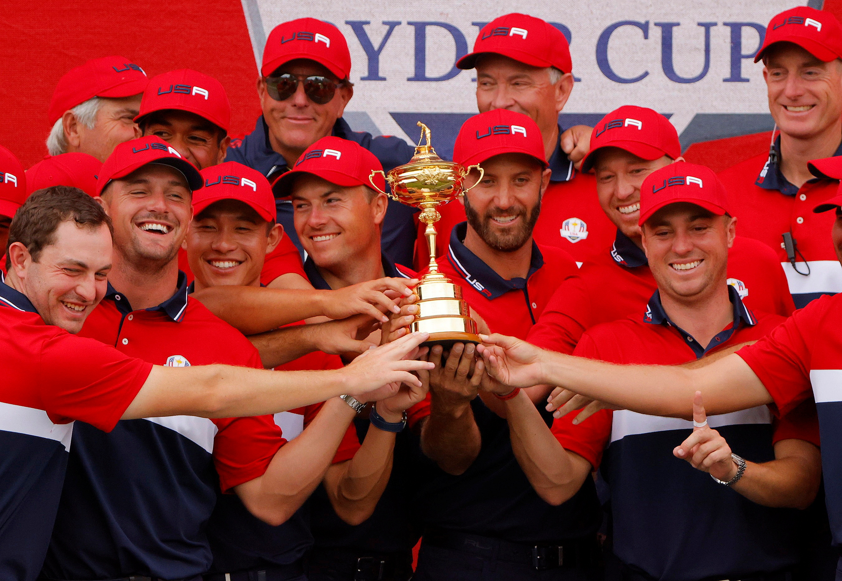 Golf - The 2020 Ryder Cup - Whistling Straits, Sheboygan, Wisconsin, U.S. - September 26, 2021 Team USA celebrate with the trophy after winning The Ryder Cup REUTERS/Brian Snyder