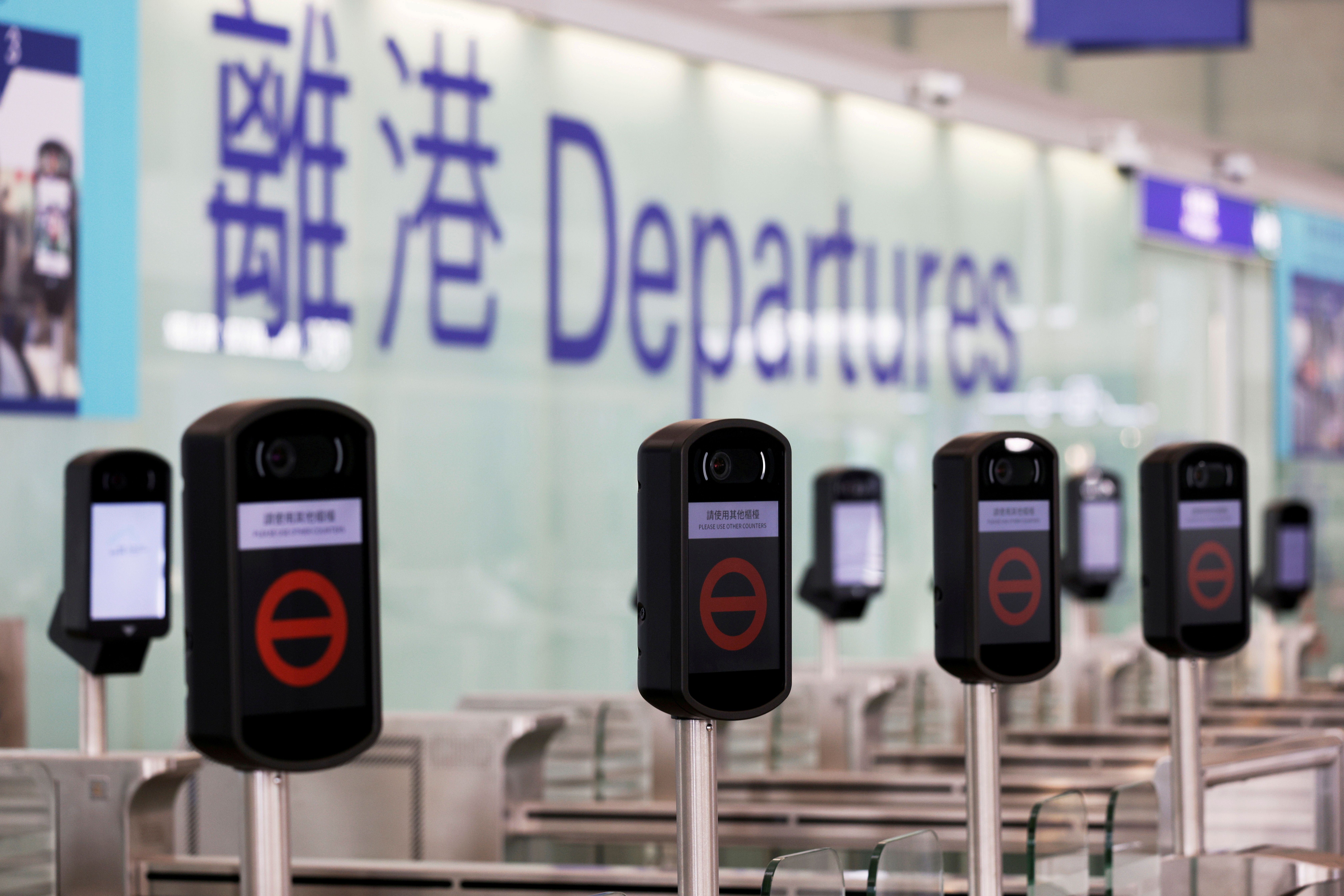 FILE PHOTO: Closed counters are seen at the departures hall of Hong Kong International Airport, following the coronavirus disease (COVID-19) outbreak, in Hong Kong, China February 2, 2021. REUTERS/Tyrone Siu