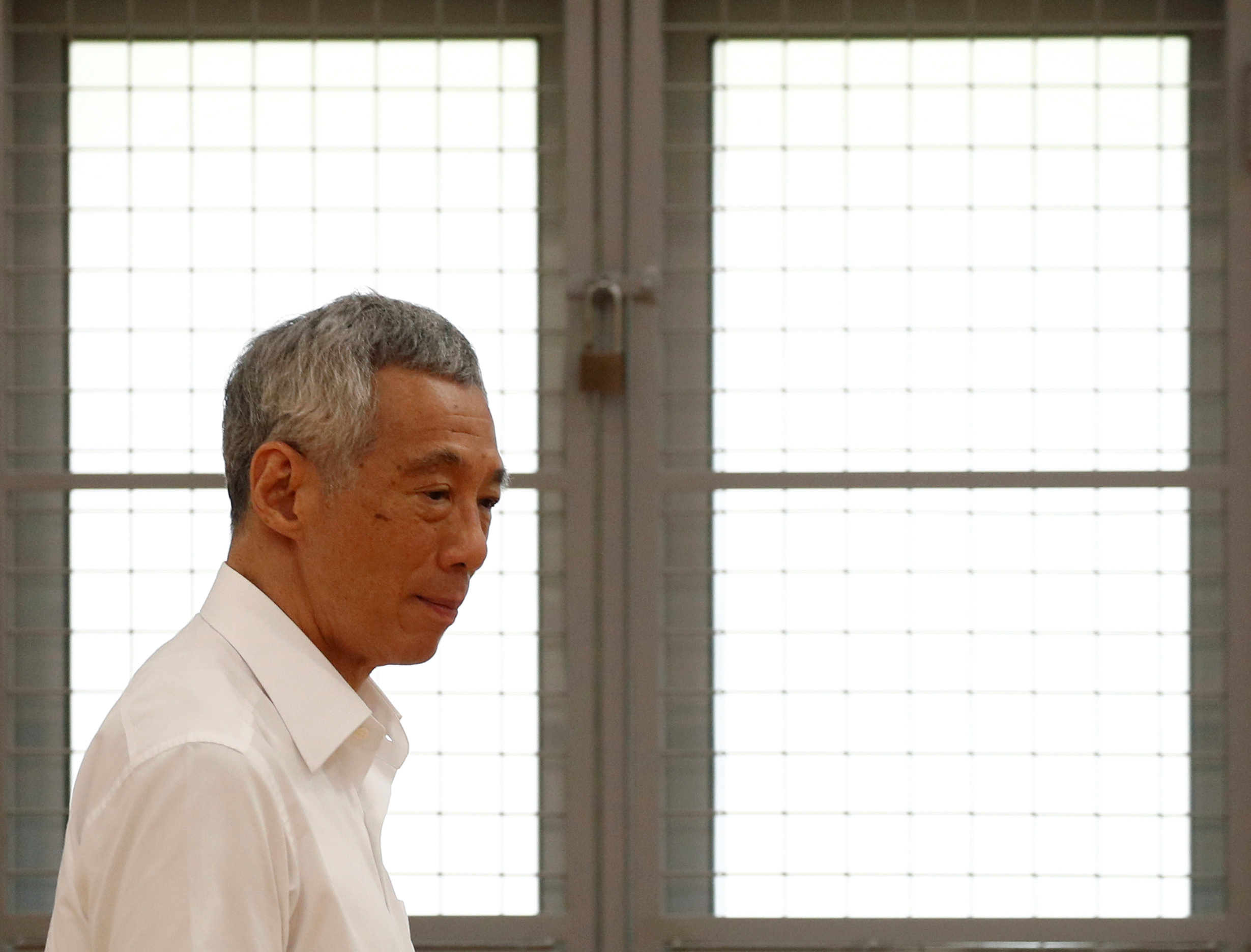 Singapore's Prime Minister Lee Hsien Loong of the People's Action Party arrives to give a speech at a nomination center ahead of the general election in Singapore June 30, 2020. REUTERS/Edgar Su