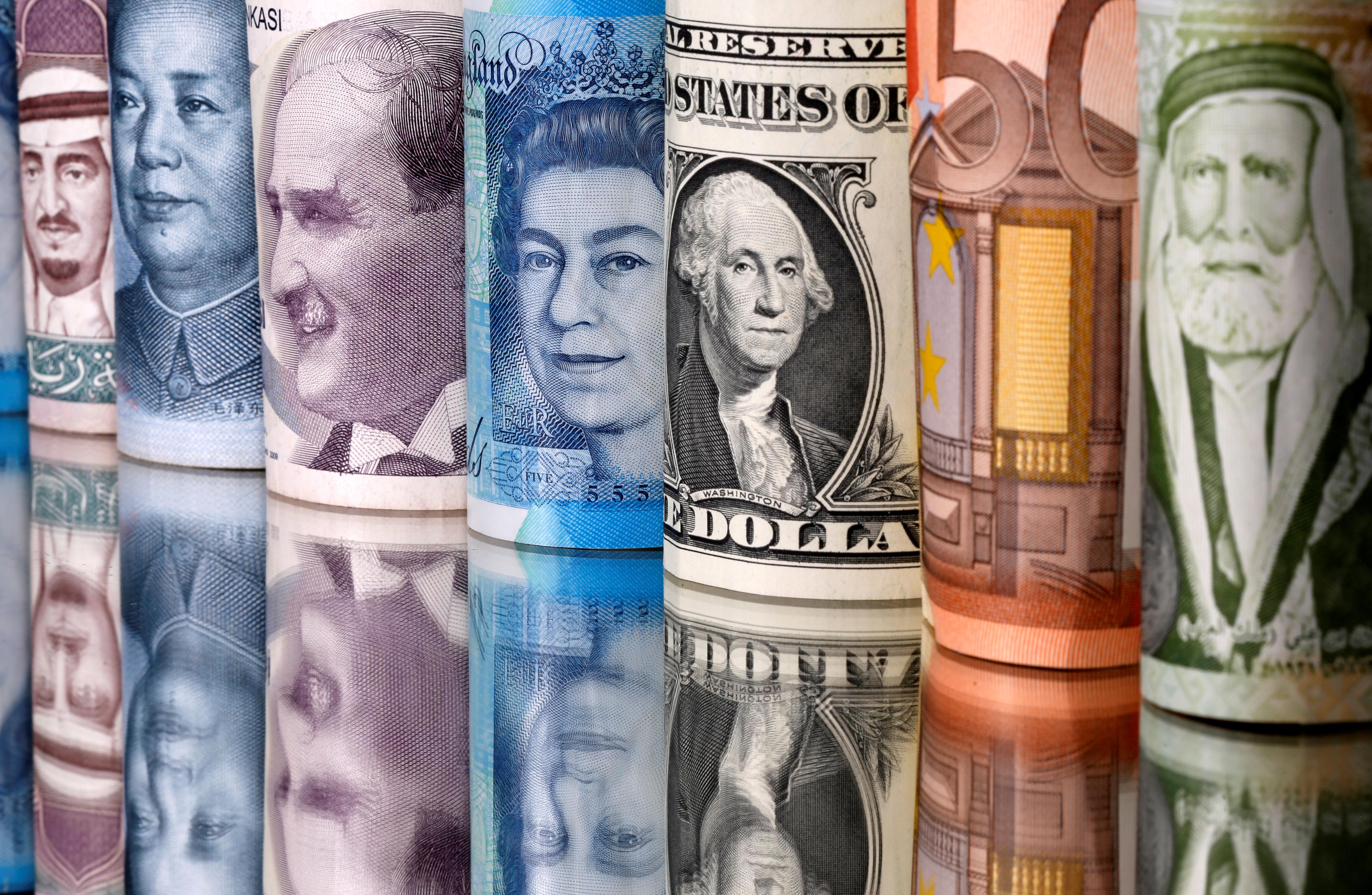 Saudi riyal, yuan, Turkish lira, pound, U.S. dollar, euro and Jordanian dinar banknotes are seen in this illustration taken January 6, 2020. REUTERS/Dado Ruvic/Illustration