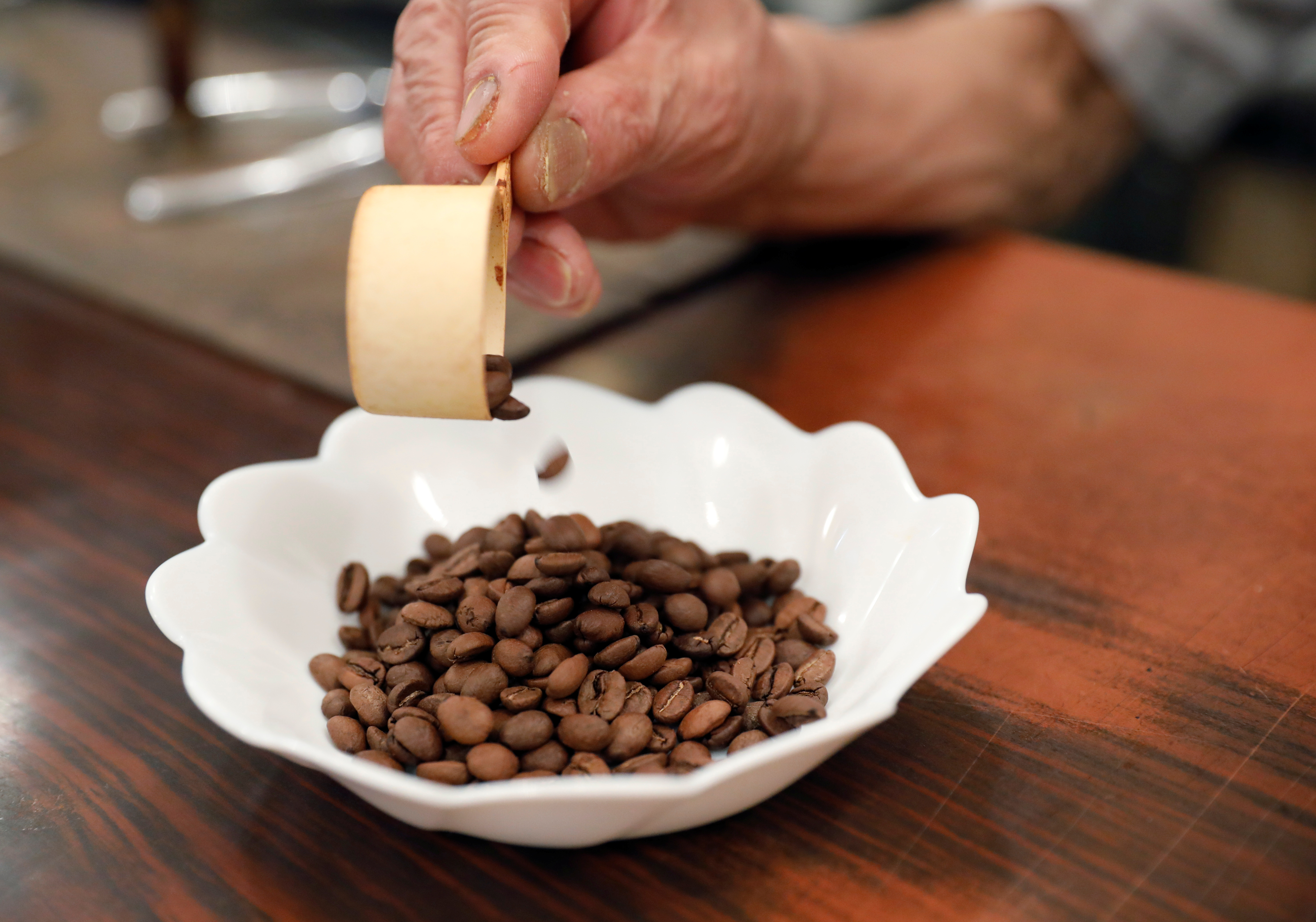 Shizuo Mori, the owner of Heckeln coffee shop prepares to grind coffee beans at his shop in Tokyo, Japan, October 8, 2021. REUTERS/Kim Kyung-Hoon