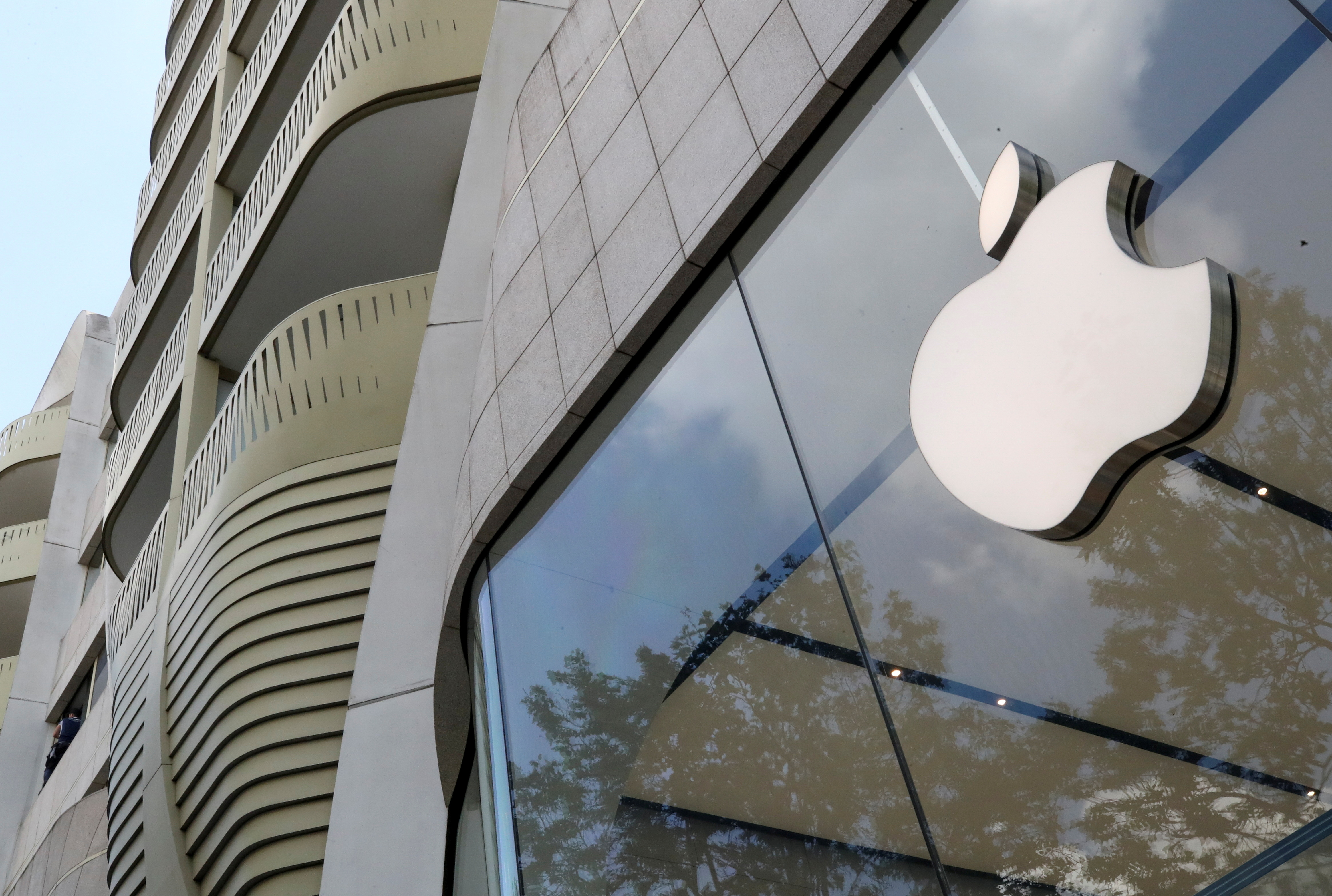 The Apple Inc logo is seen at the entrance to the Apple store in Brussels, Belgium July 2, 2021. REUTERS/Yves Herman