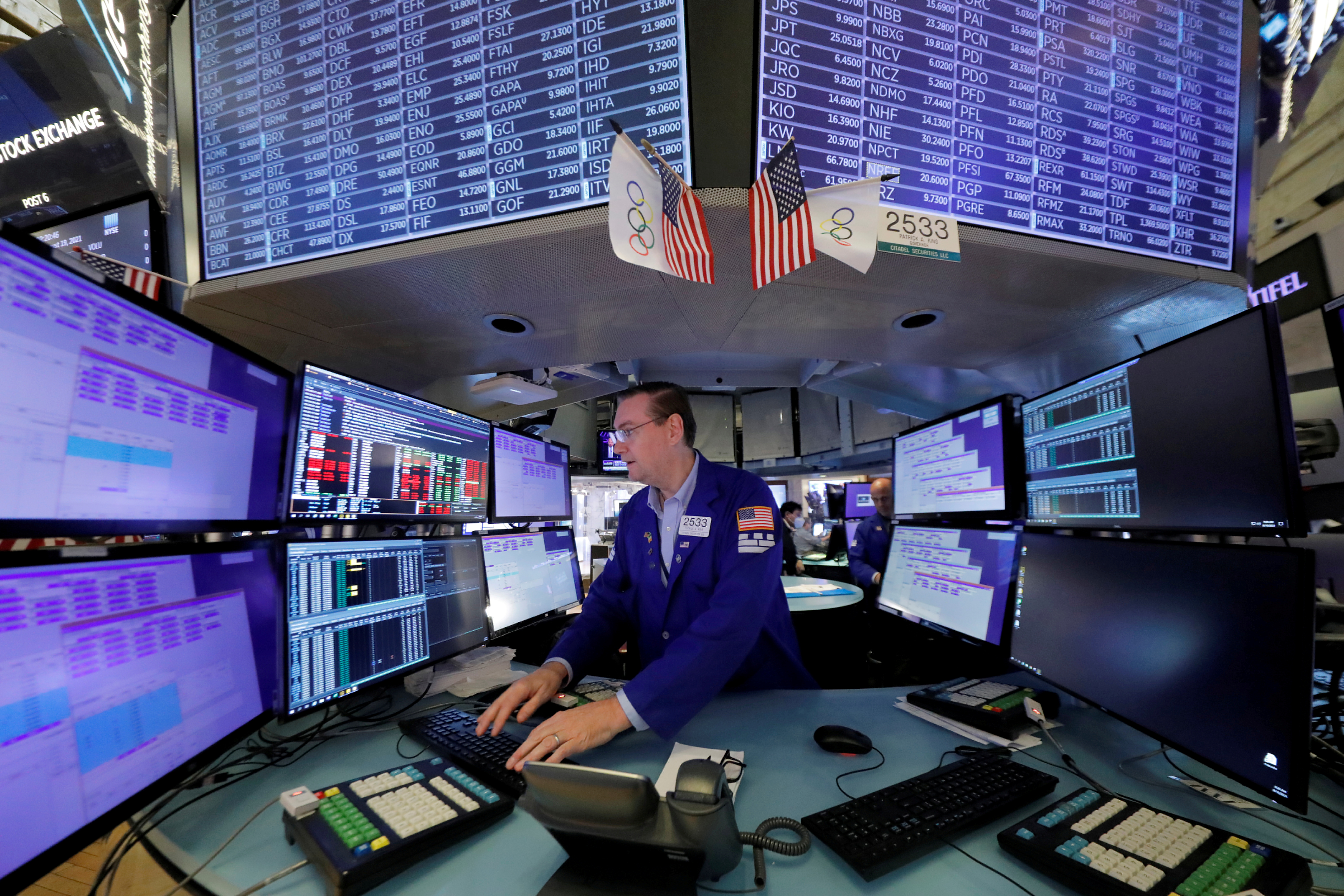 A trader works at the New York Stock Exchange (NYSE) in Manhattan, New York City, U.S., August 19, 2021. REUTERS/Andrew Kelly/File Photo