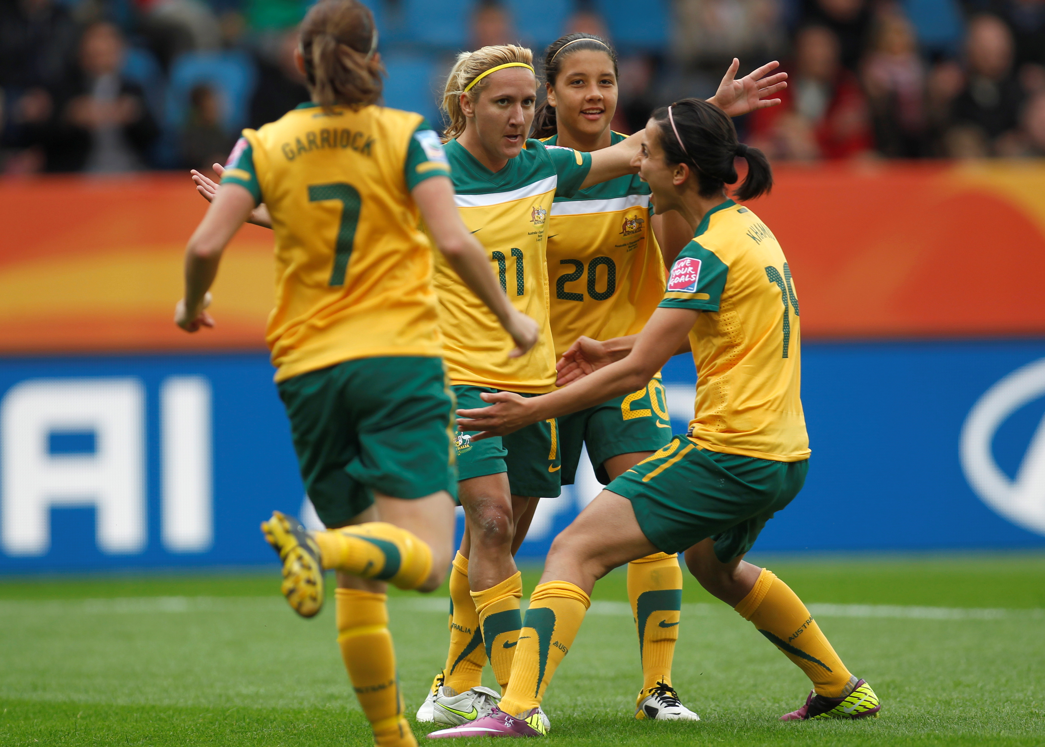 Lisa de Vanna  (2L) Samantha Kerr (2R) and Leena Khamis of Australia celebrate a goal against of Equatorial Guinea during their Women's World Cup Group D soccer match in Bochum July 3, 2011.    REUTERS/Ina Fassbender