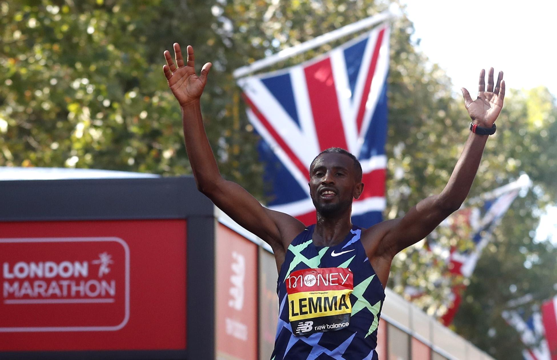 Athletics - London Marathon - London, Britain - October 3, 2021 Ethiopia's Sisay Lemma celebrates winning the elite men's race REUTERS/Matthew Childs