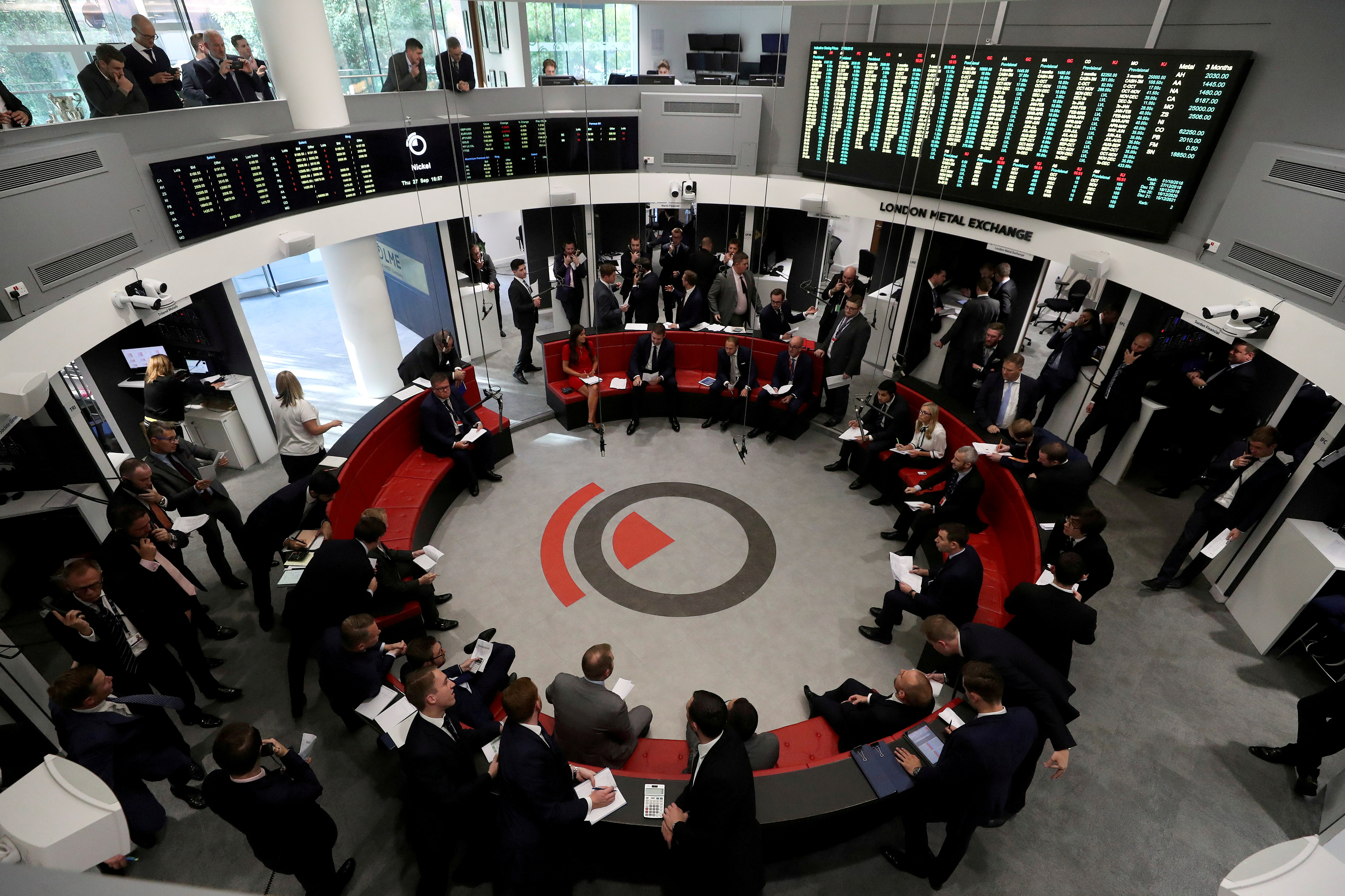Traders work on the floor of the London Metal Exchange in London, Britain, September 27, 2018. REUTERS/Simon Dawson/File Photo
