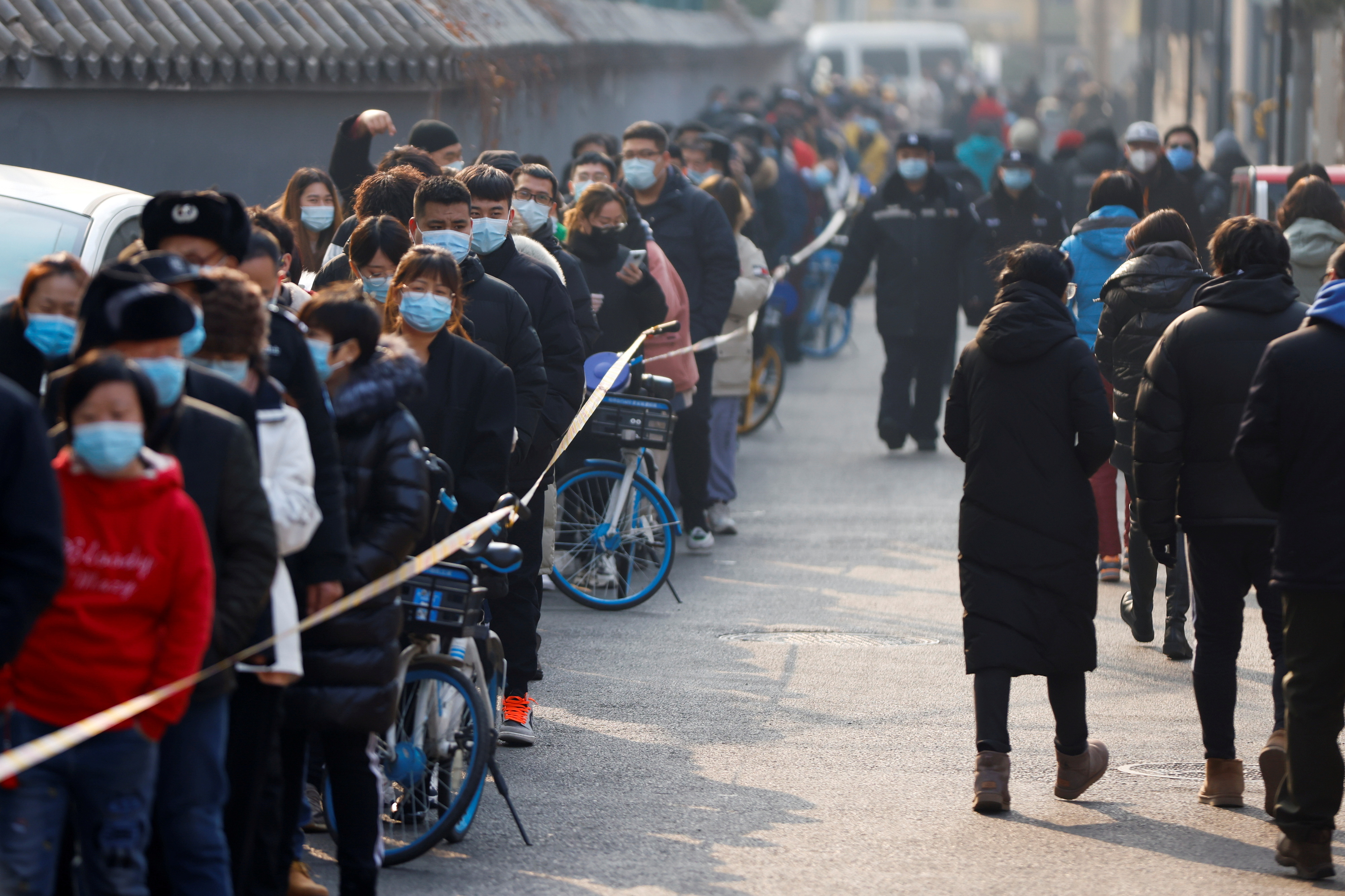 People line up to get their nucleic acid test following the outbreak of the coronavirus disease (COVID-19) in Beijing, China January 22, 2021. REUTERS/Carlos Garcia Rawlins