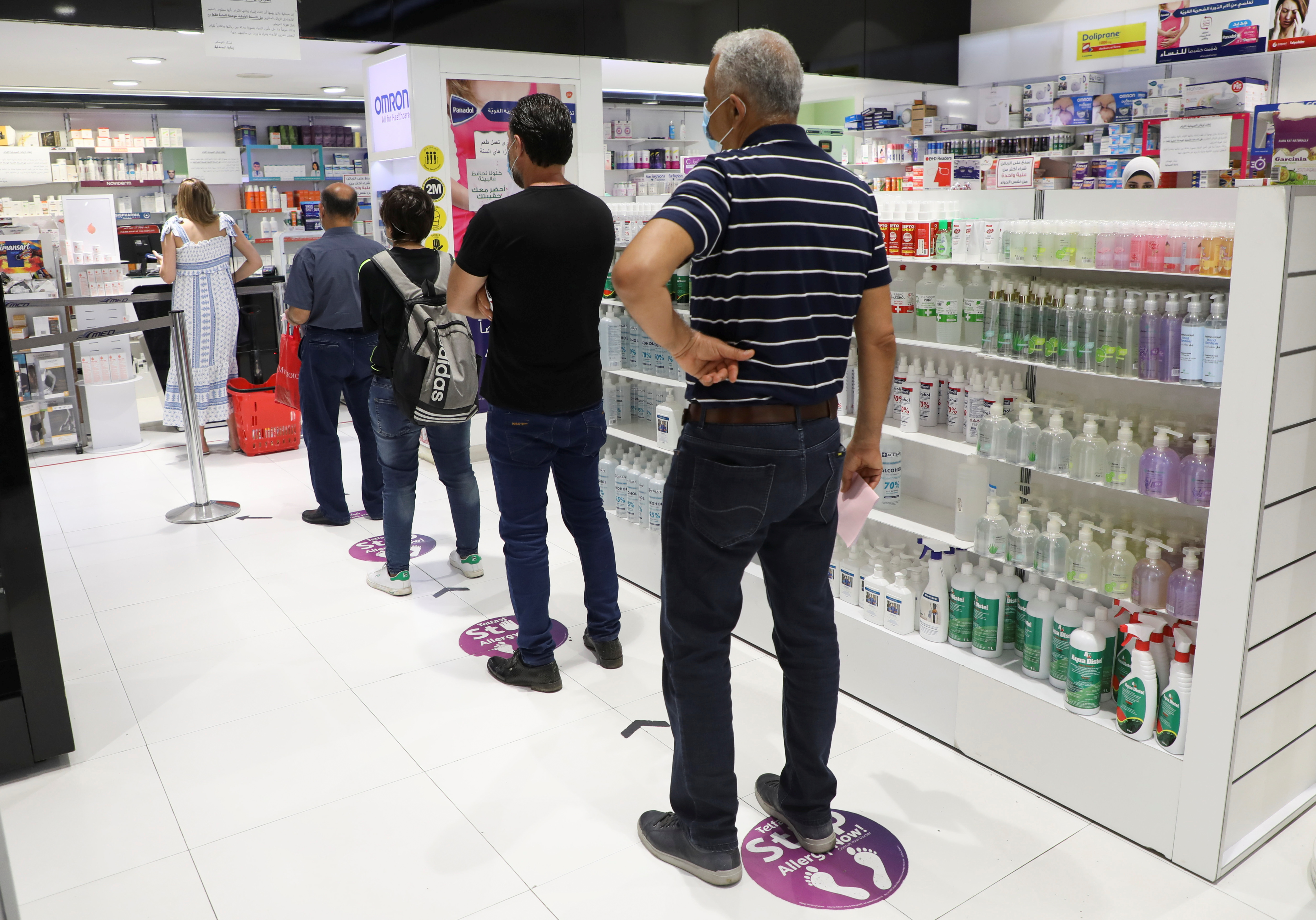 People queue inside a pharmacy in Beirut, Lebanon May 28, 2021. Picture taken May 28, 2021. REUTERS/Mohamed Azakir