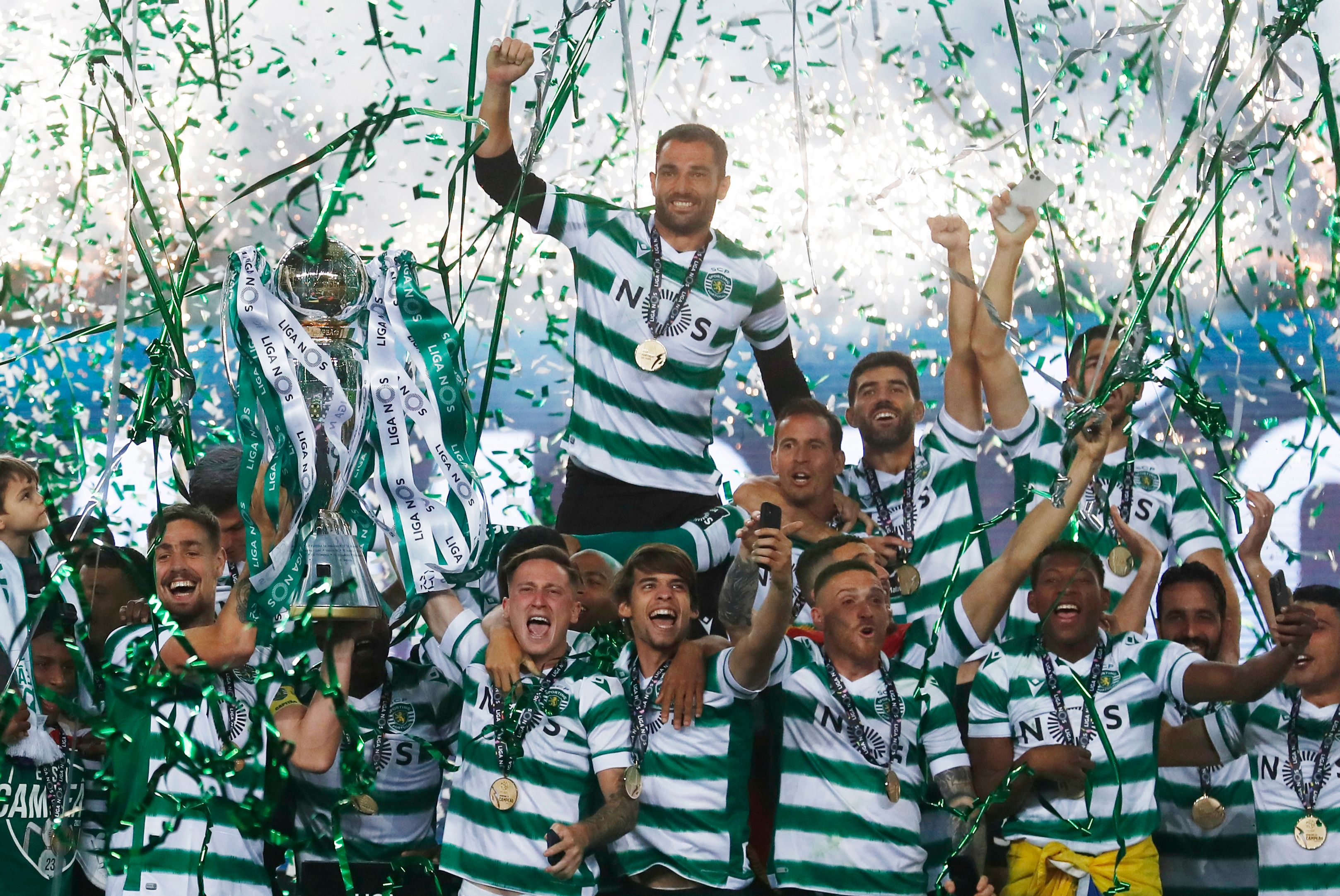 Sporting title celebrations marred as fans clash with riot police | Reuters