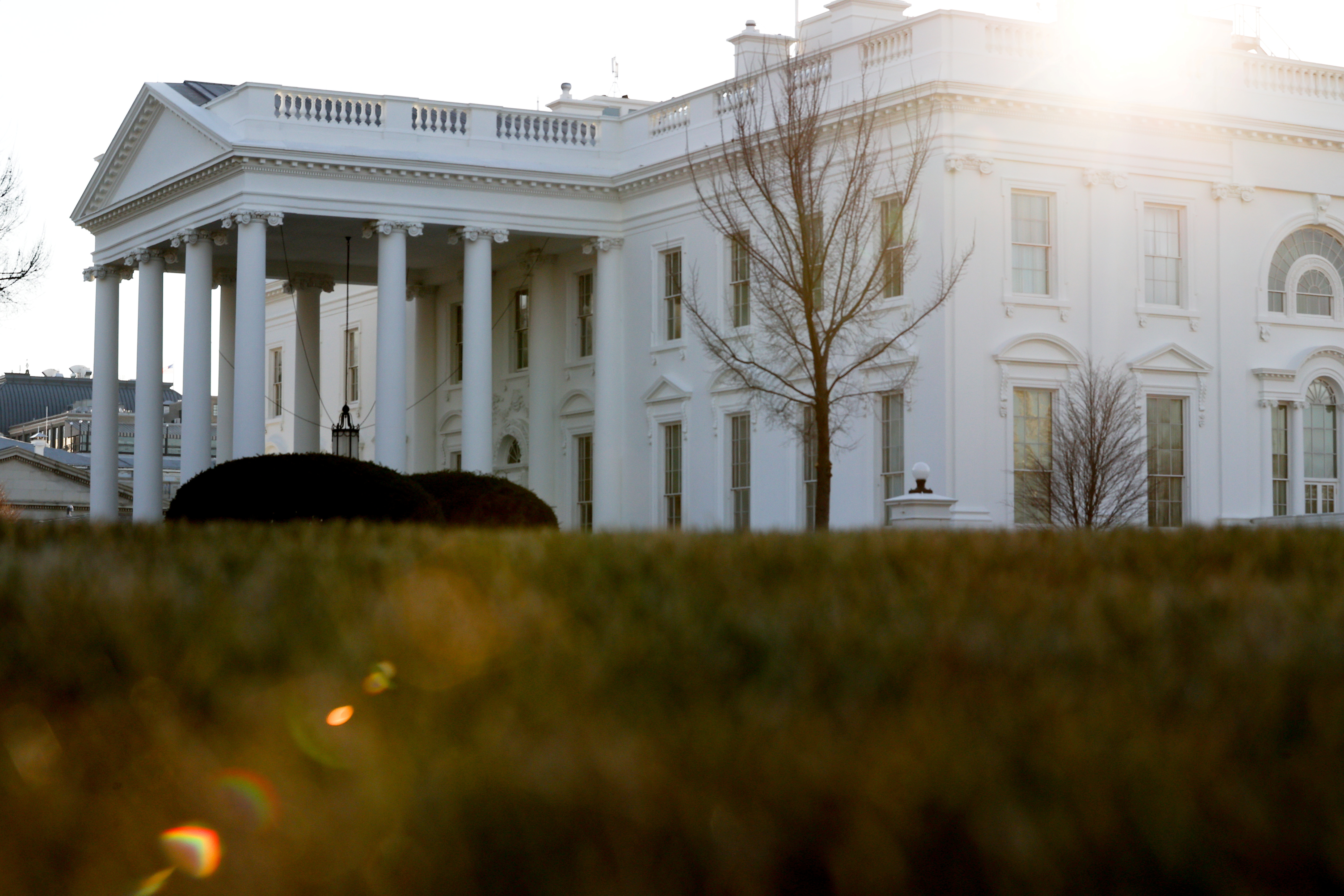 A general view of the sun rising behind the White House in Washington, U.S. January 22, 2021.  REUTERS/Jonathan Ernst