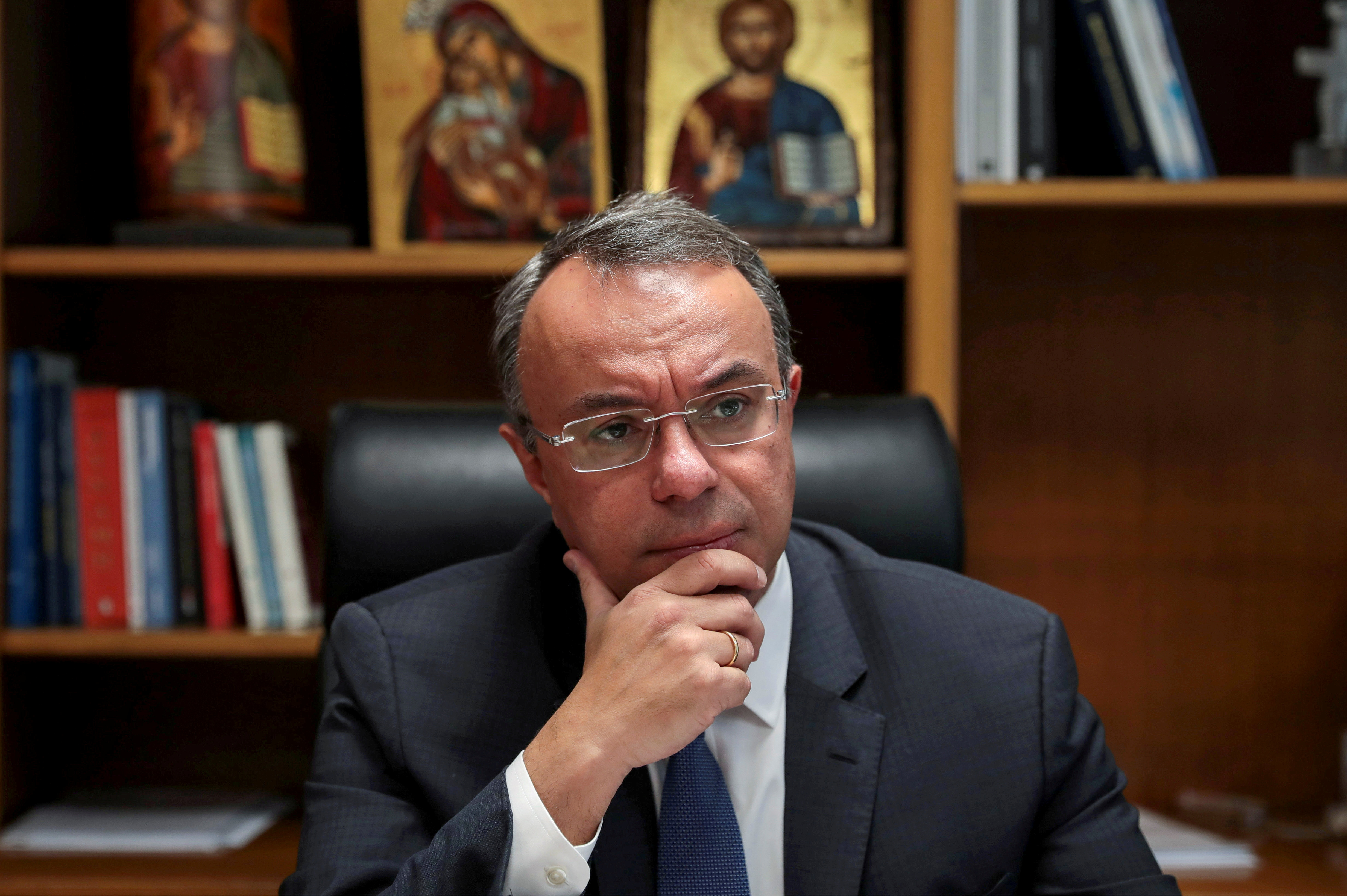 Greek Finance Minister Christos Staikouras pauses during an interview with Reuters at his office in the Finance Ministry in Athens, Greece, December 17, 2019. REUTERS/Costas Baltas