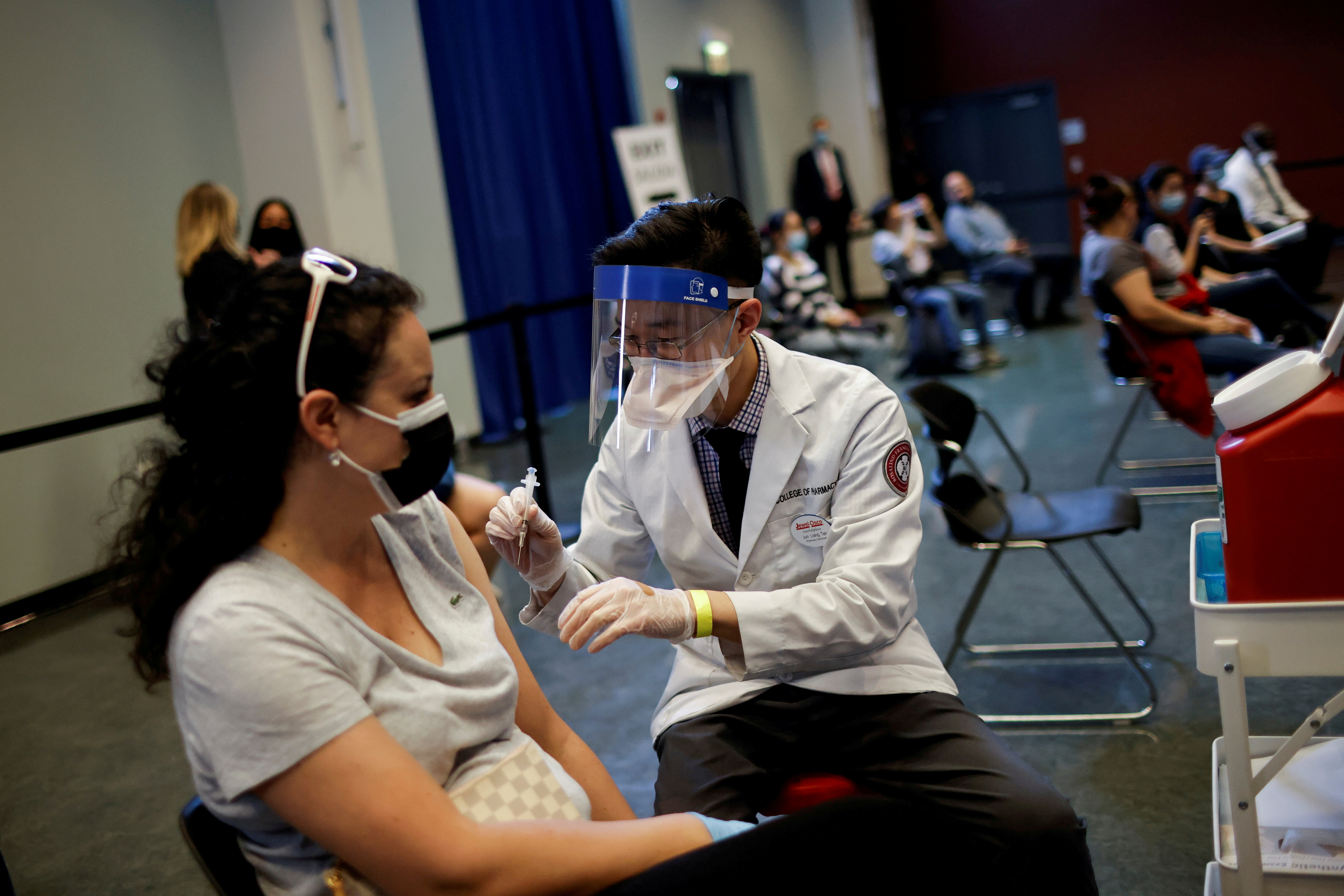 A woman receives a dose of the Johnson & Johnson coronavirus disease (COVID-19) vaccine at vaccination center in Chinatown, in Chicago, Illinois, U.S., April 6, 2021. REUTERS/Carlos Barria
