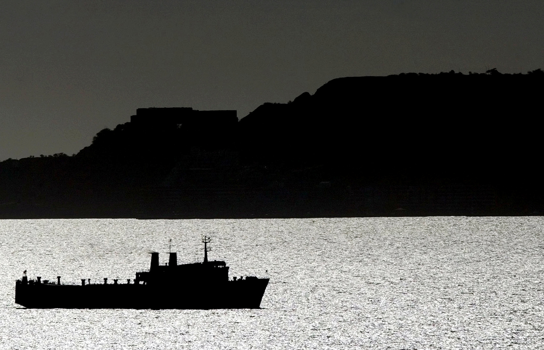 An oil tanker is seen in the sea east of Caracas in this 2003 file photo. REUTERS/Jorge Silva//File Photo