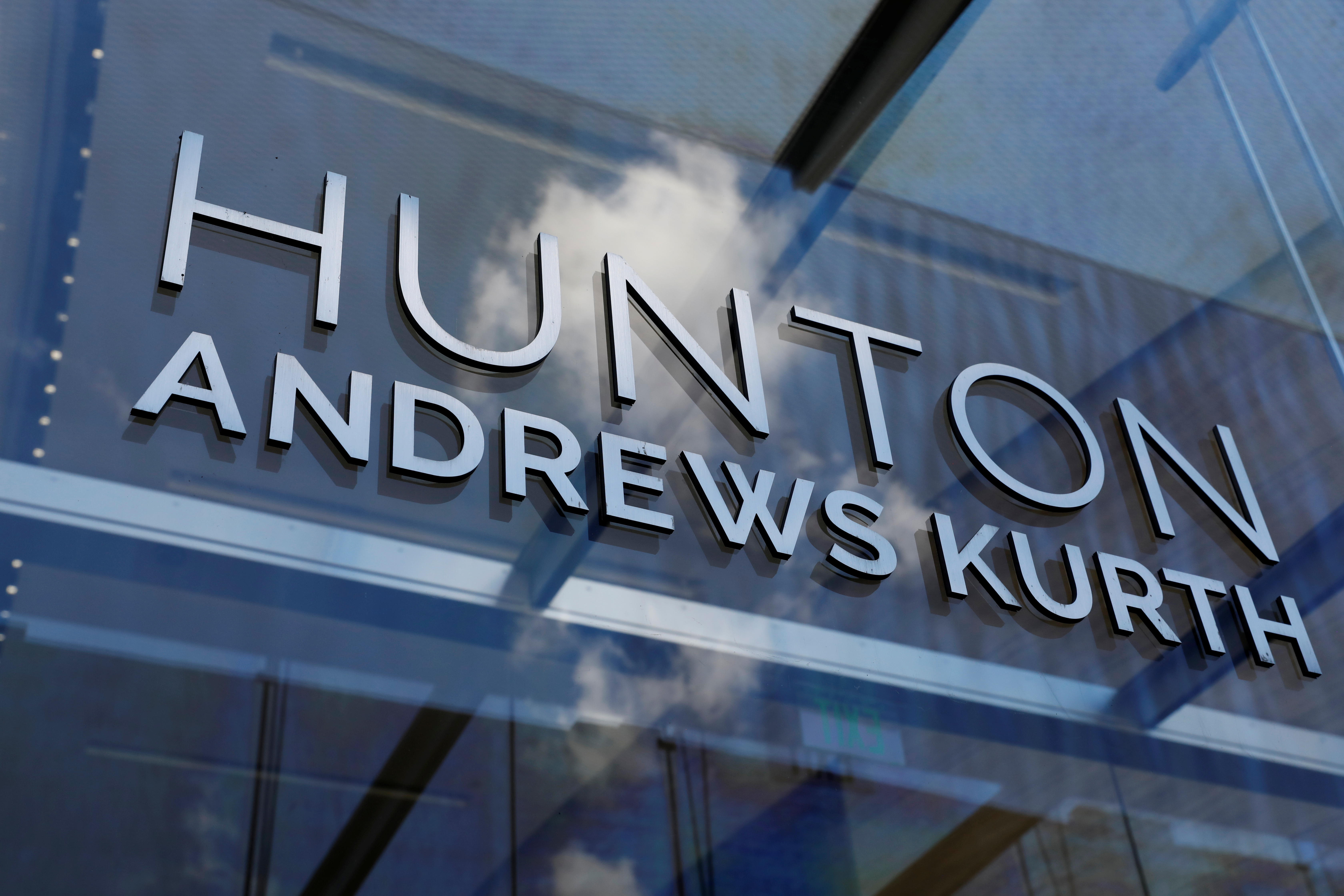 Signage is seen outside of the law firm Hunton Andrews Kurth in Washington, D.C., U.S., August 30, 2020. REUTERS/Andrew Kelly