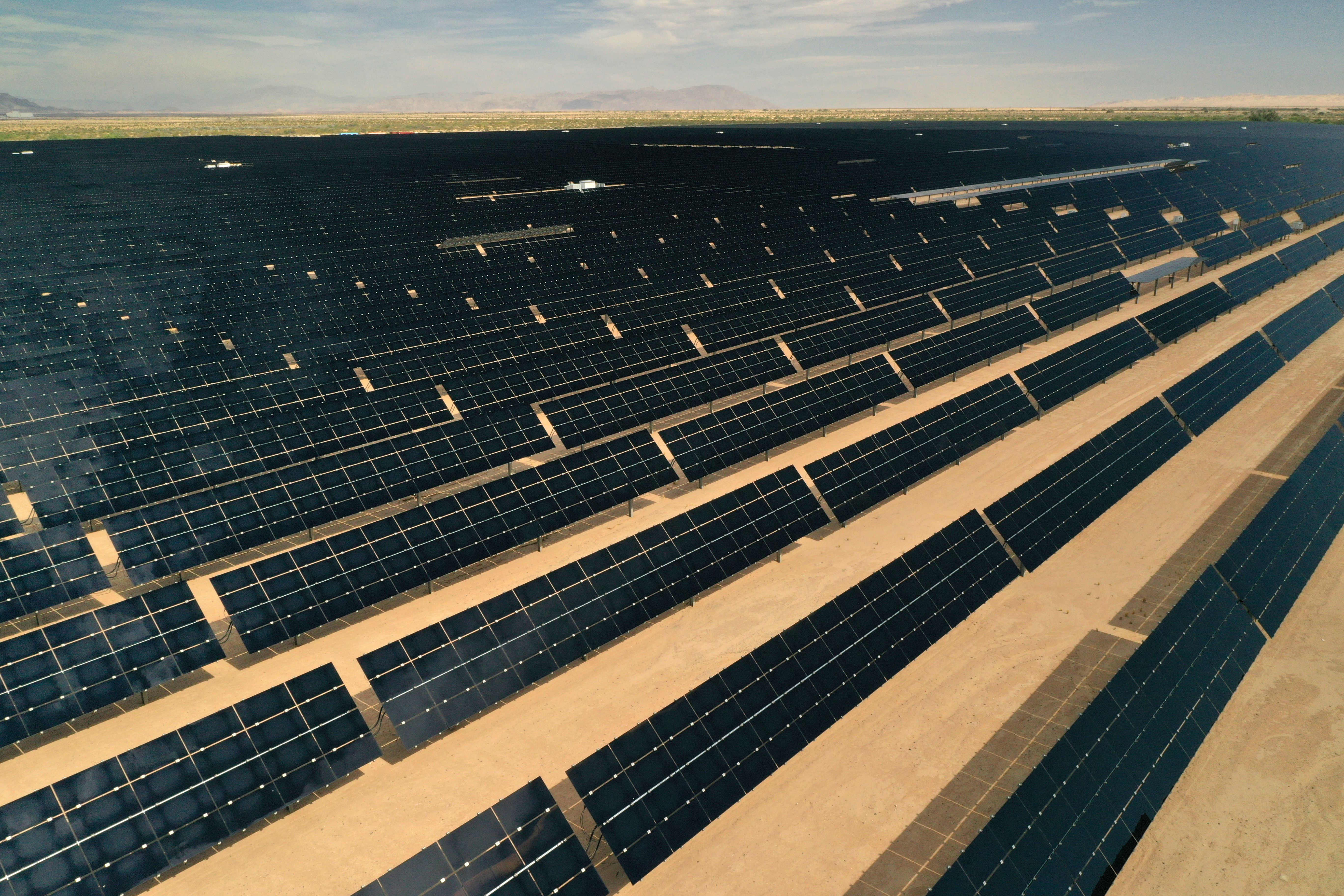 Arrays of photovoltaic solar panels are seen at the Tenaska Imperial Solar Energy Center South in this aerial photo taken over El Centro, California, U.S., May 29, 2020. Picture taken with a drone. REUTERS/Bing Guan/File Photo
