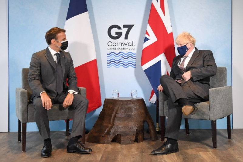 Britain's Prime Minister Boris Johnson and France's President Emmanuel Macron attend a bilateral meeting during G7 summit in Carbis Bay, Cornwall, Britain, June 12, 2021. Stefan Rousseau/Pool via REUTERS