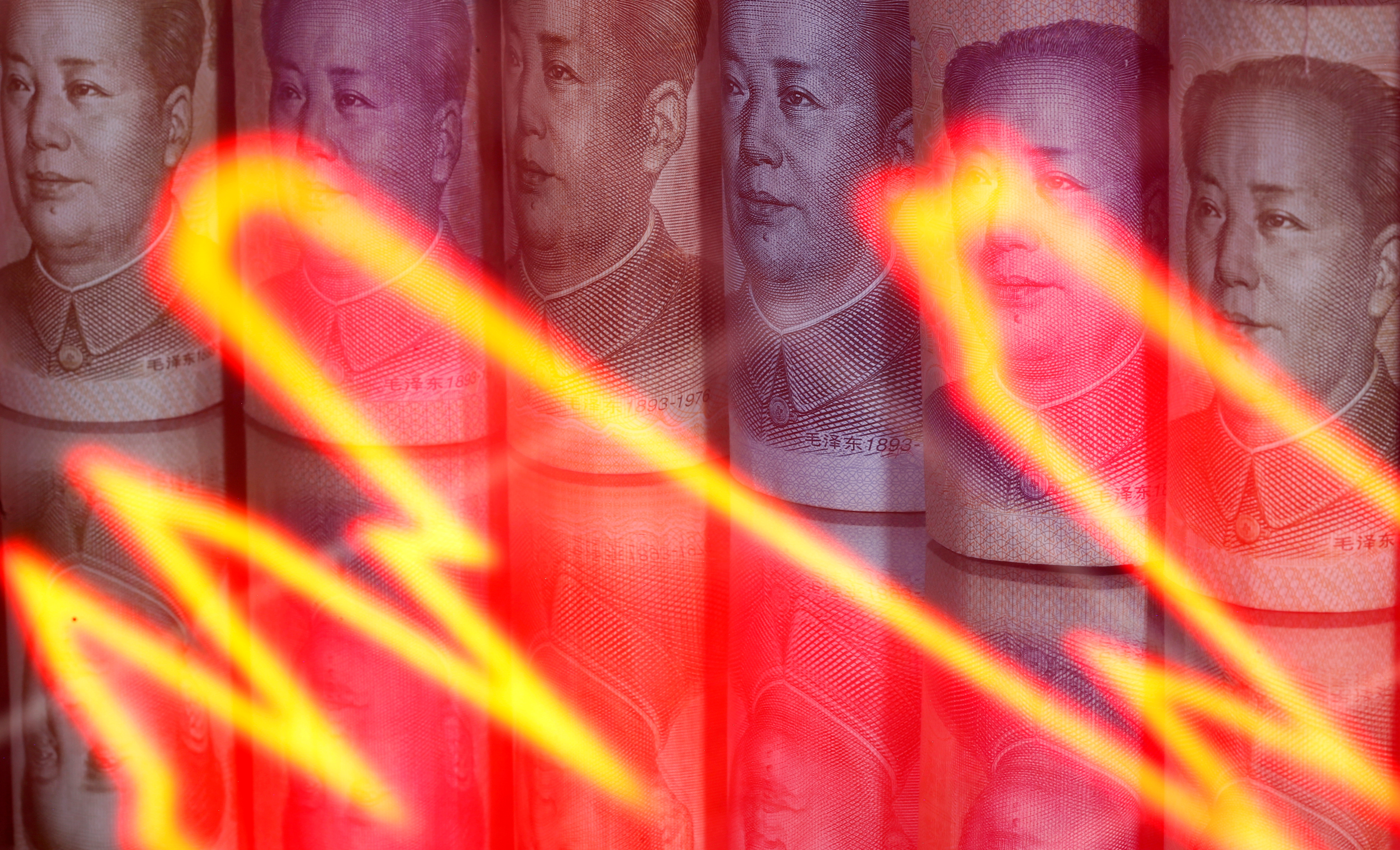 Chinese yuan banknotes are seen behind illuminated stock graph in this illustration taken February 10, 2020. REUTERS/Dado Ruvic/Illustration/File Photo