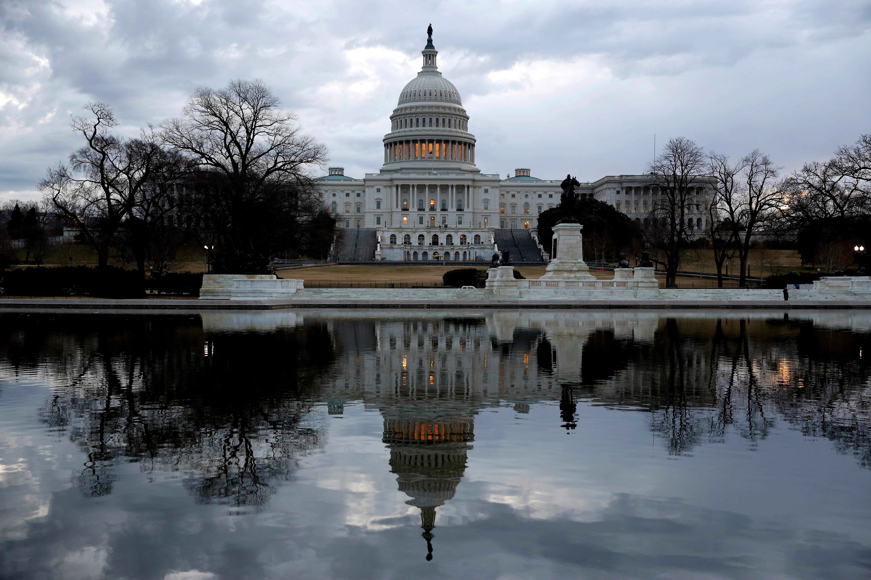 Clouds pass over the U.S. Capitol in Washington, U.S., January 22, 2018. REUTERS/Joshua Roberts/File Photo