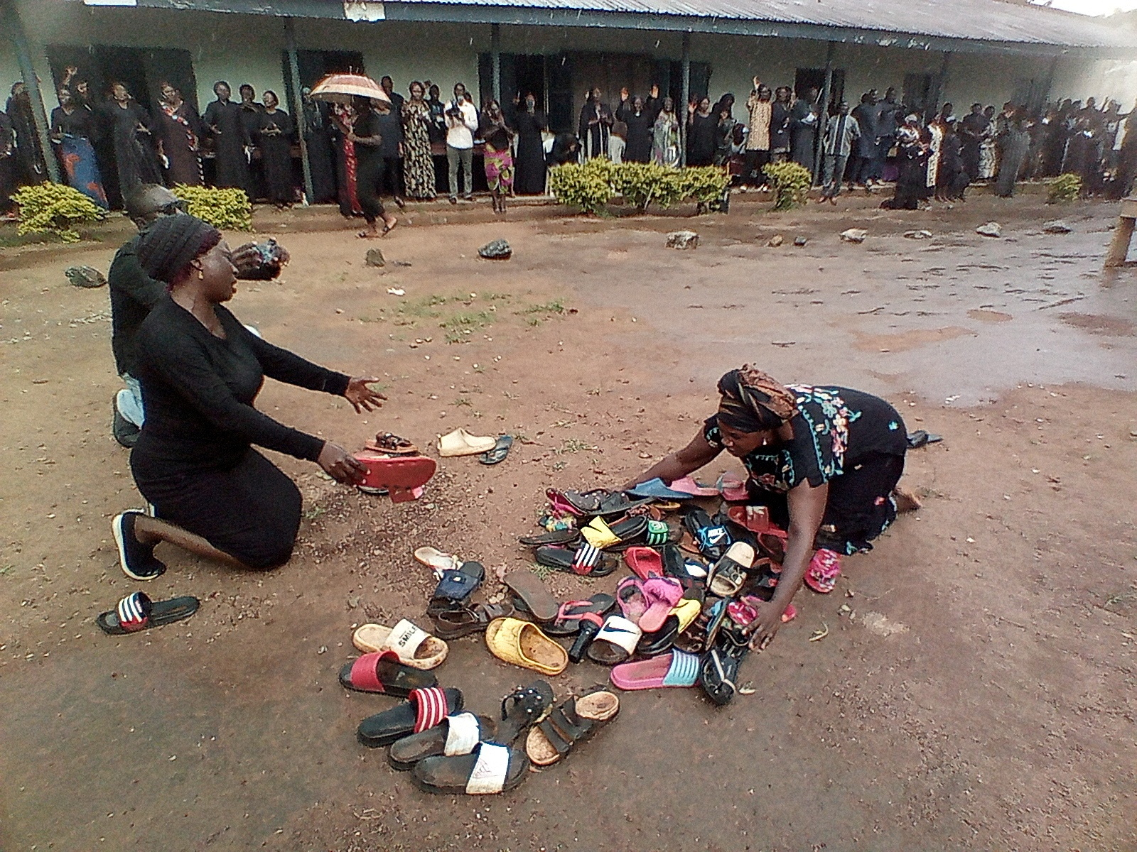 Parents of students abducted at Bethel Baptist High School pray for their safe return around discarded shoes left behind by the children, in Kaduna, Nigeria July 9, 2021. REUTERS/Bosan Yakusak /File Photo