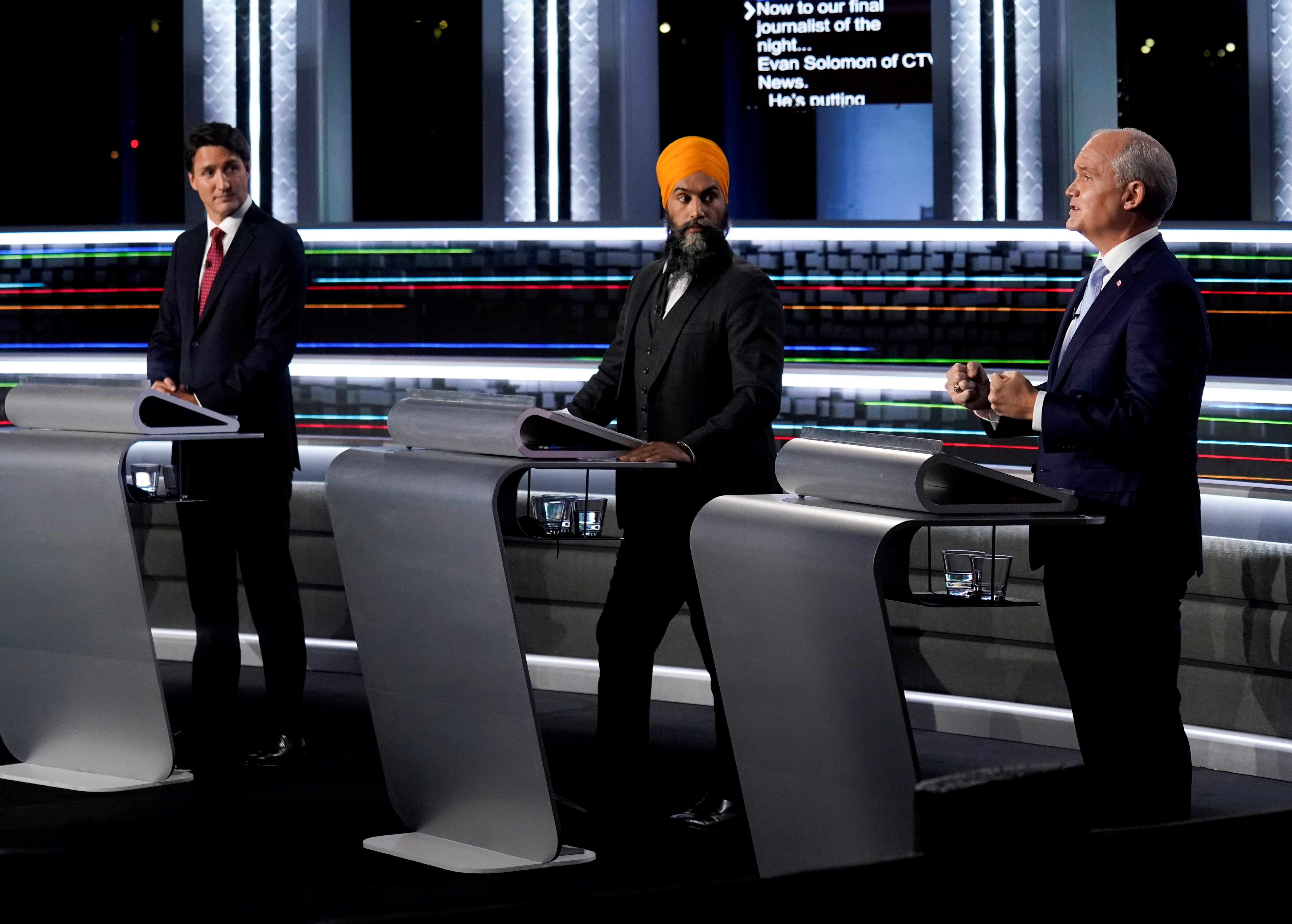 Liberal Leader Justin Trudeau, left to right, NDP Leader Jagmeet Singh, and Conservative Leader Erin O'Toole take part in the federal election English-language Leaders debate in Gatineau, Canada, September 9, 2021.  Adrian Wyld/Pool via REUTERS/File Photo