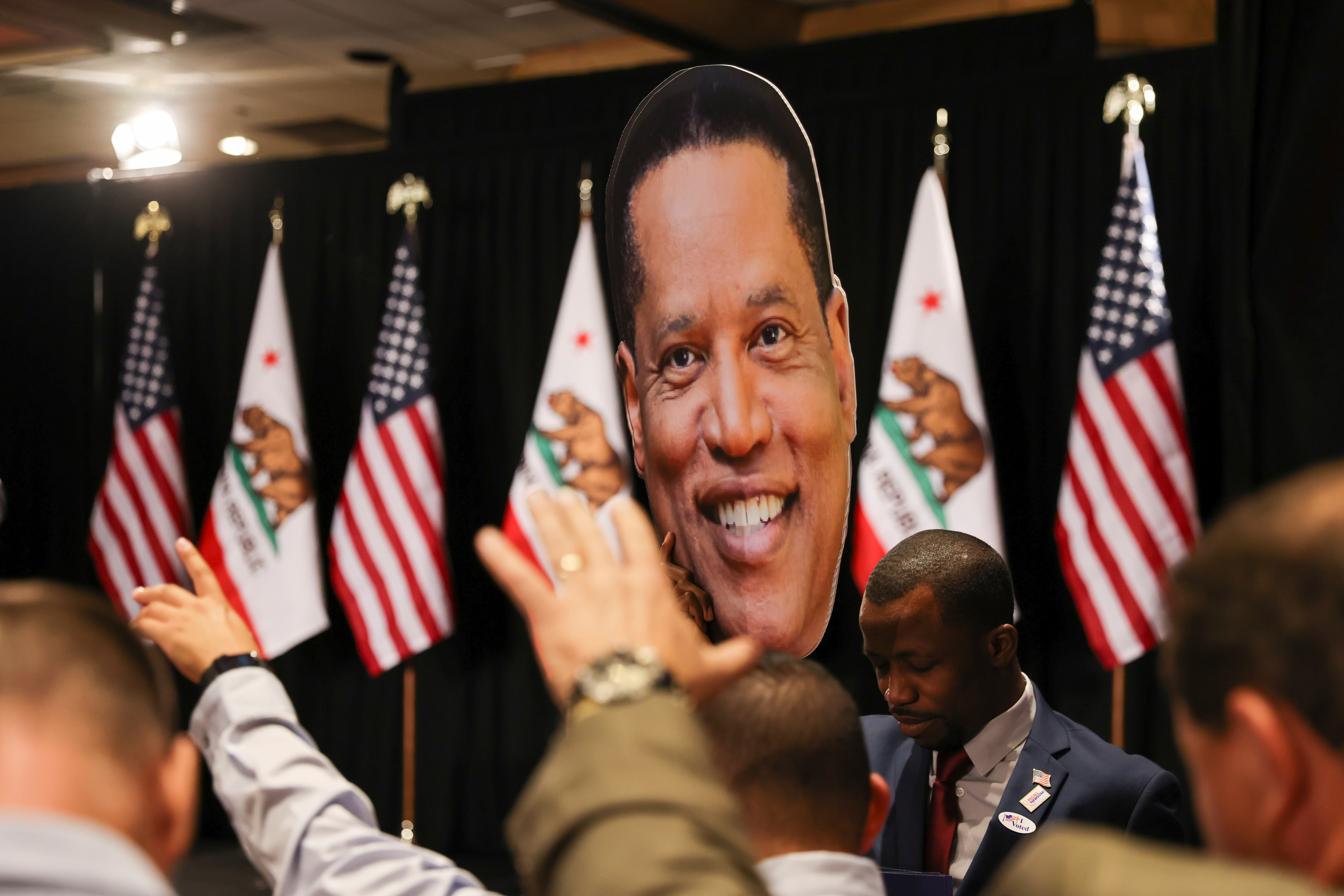 Supporters pray as they gather at Larry Elder's election night headquarters in Costa Mesa, California, U.S., September 14, 2021. REUTERS/Mike Blake