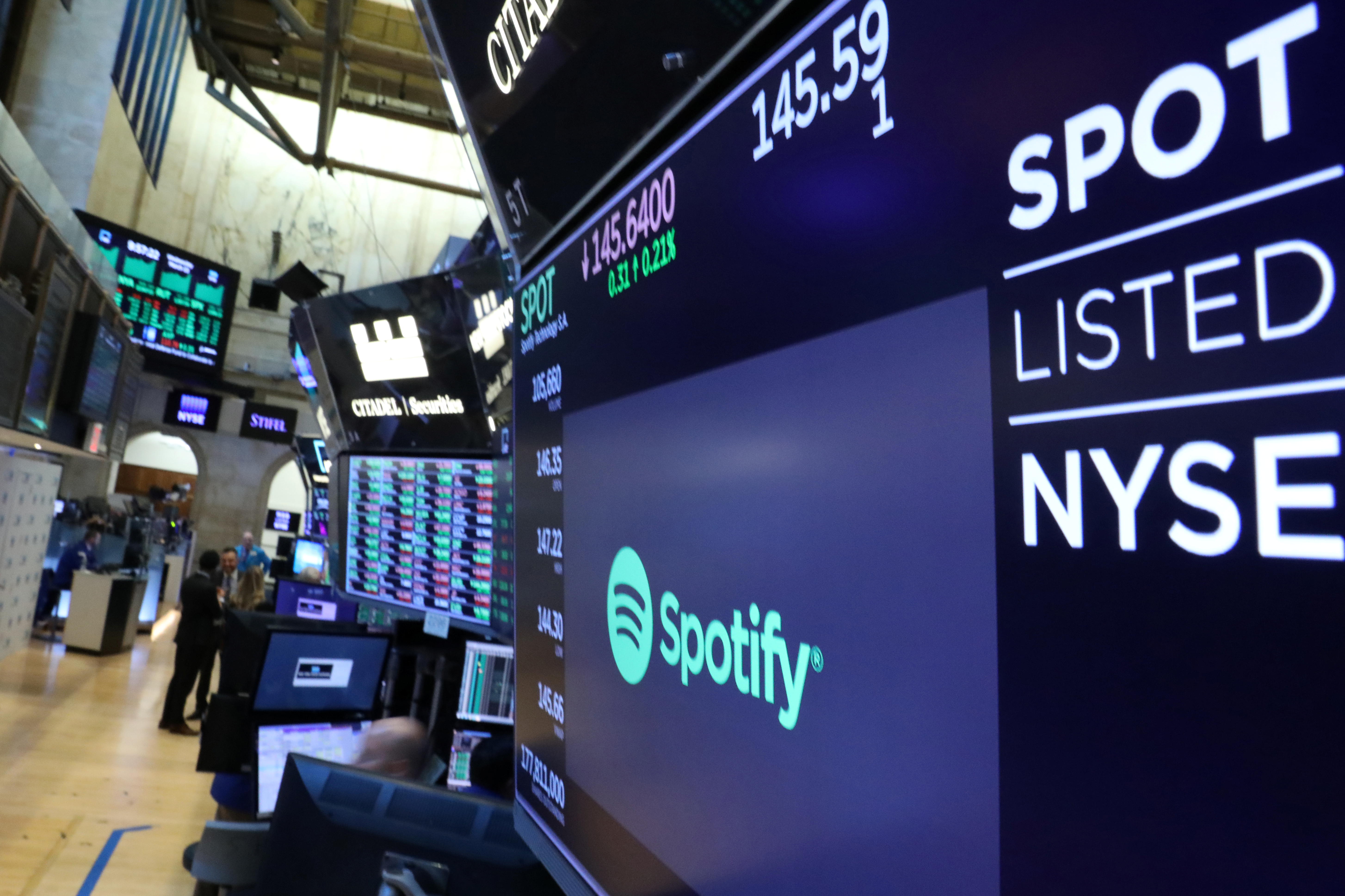A screen displays the company logo and trading info for Spotify on the floor at the New York Stock Exchange (NYSE) in New York, U.S., March 13, 2019. REUTERS/Brendan McDermid