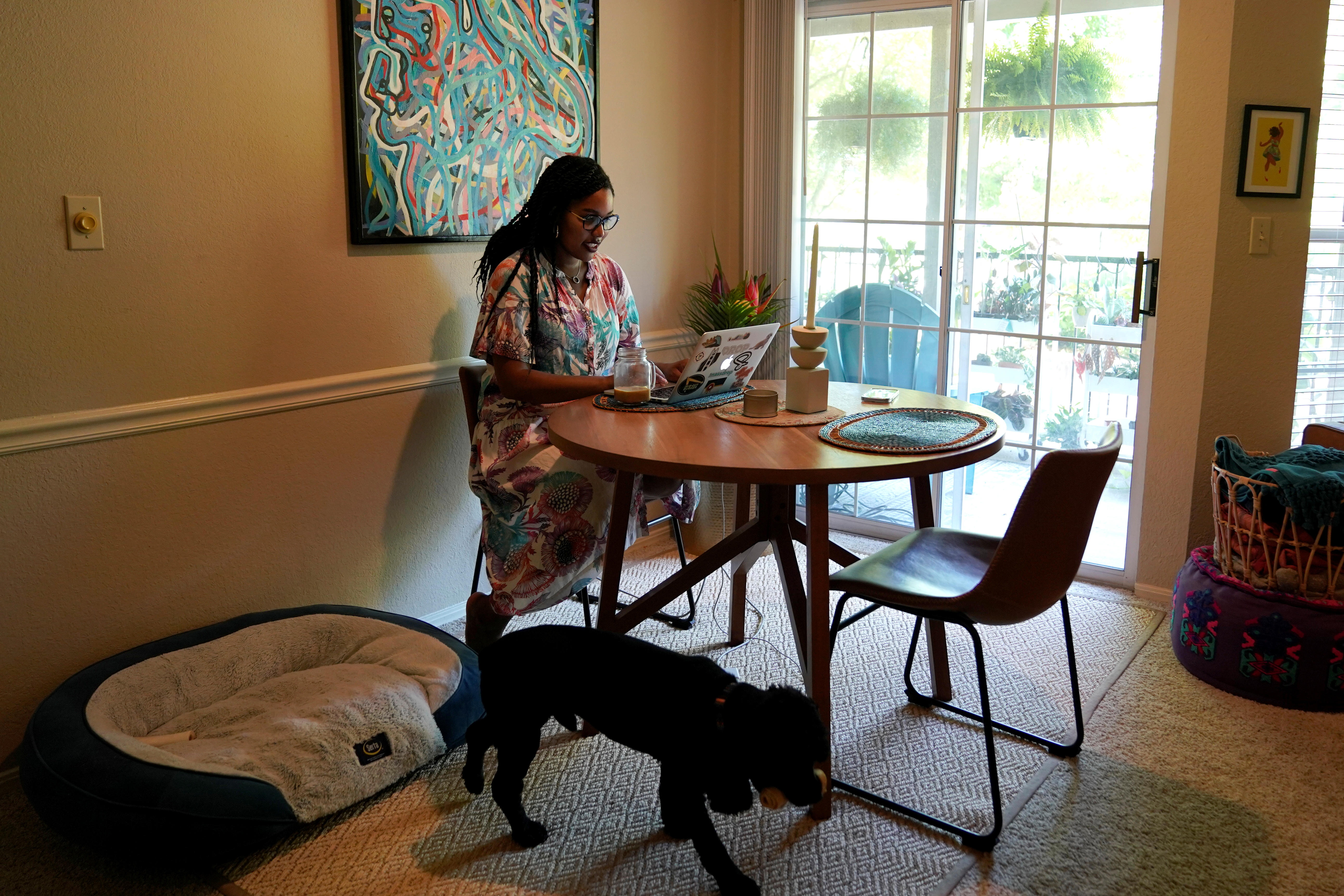 Jaleesa Garland, a marketing manager at an e-commerce startup who relocated from the Bay Area at the start of the COVID-19 pandemic, works in her apartment in Tulsa, Oklahoma, U.S., July 9, 2021. REUTERS/Nick Oxford