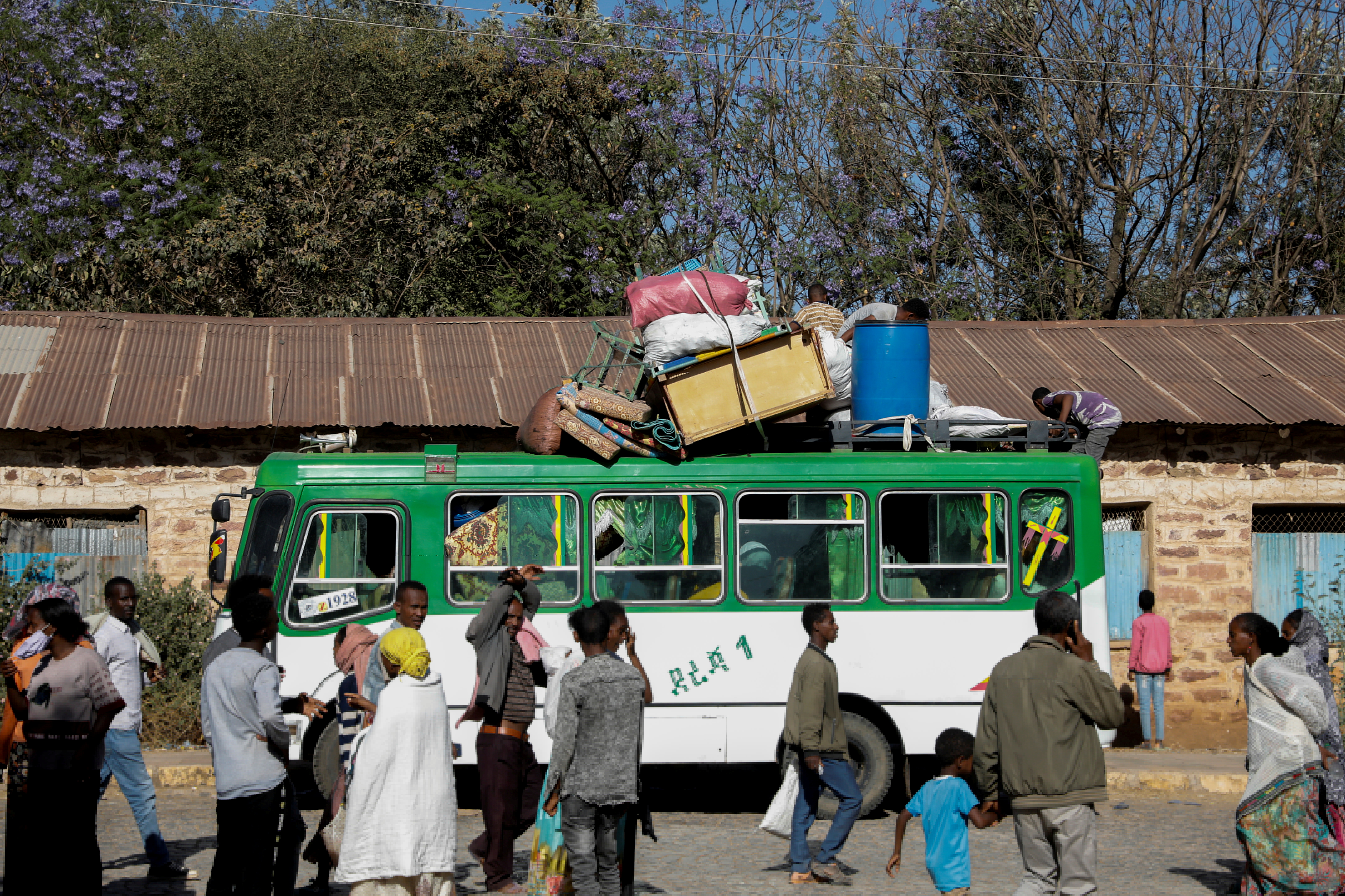 A bus carrying displaced people arrives at the Tsehaye primary school, which was turned into a temporary shelter for people displaced by conflict, in the town of Shire, Tigray region, Ethiopia, March 14, 2021. REUTERS/Baz Ratner/File Photo
