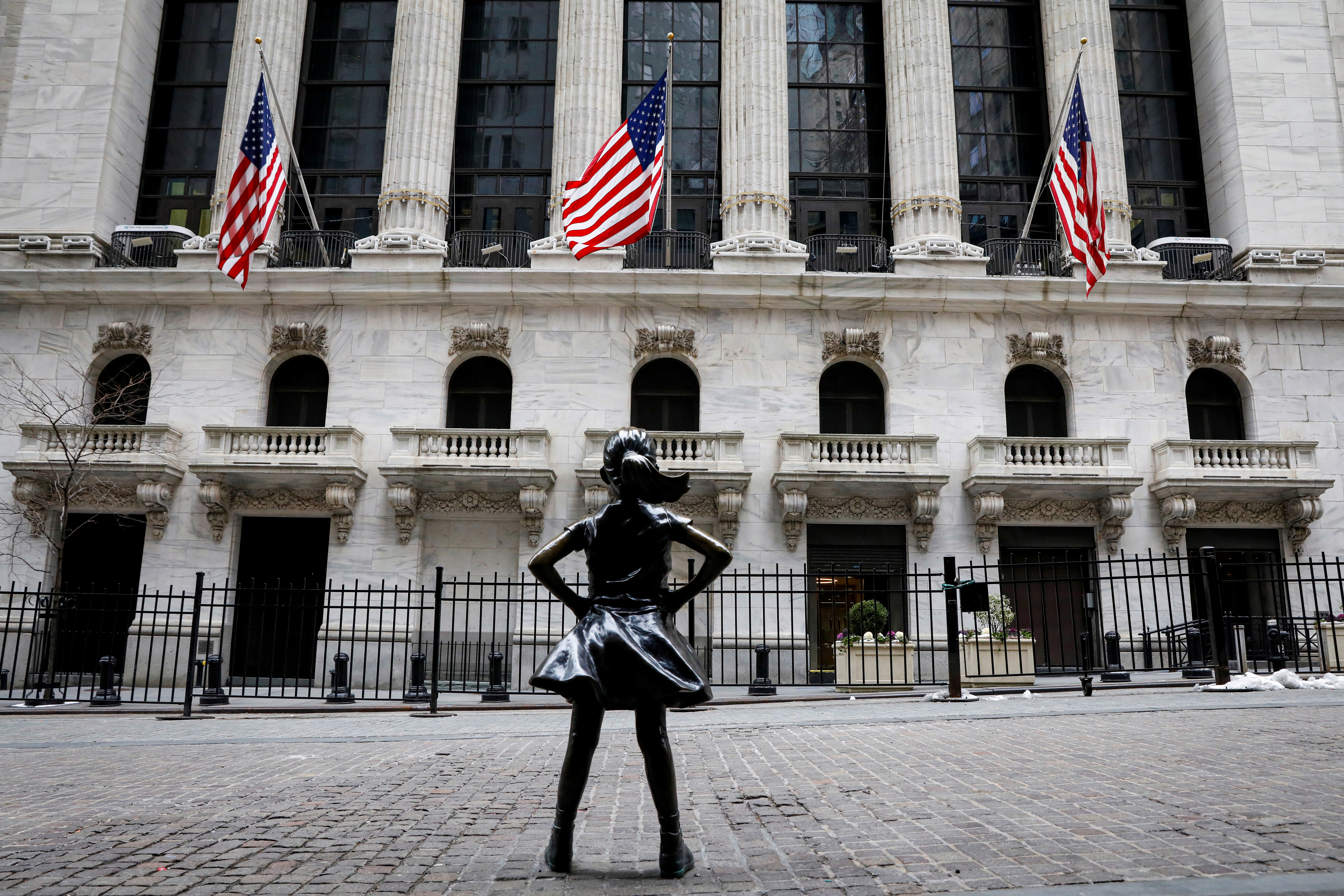The Fearless Girl statue is seen outside the New York Stock Exchange (NYSE) in New York, U.S., February 12, 2021. REUTERS/Brendan McDermid