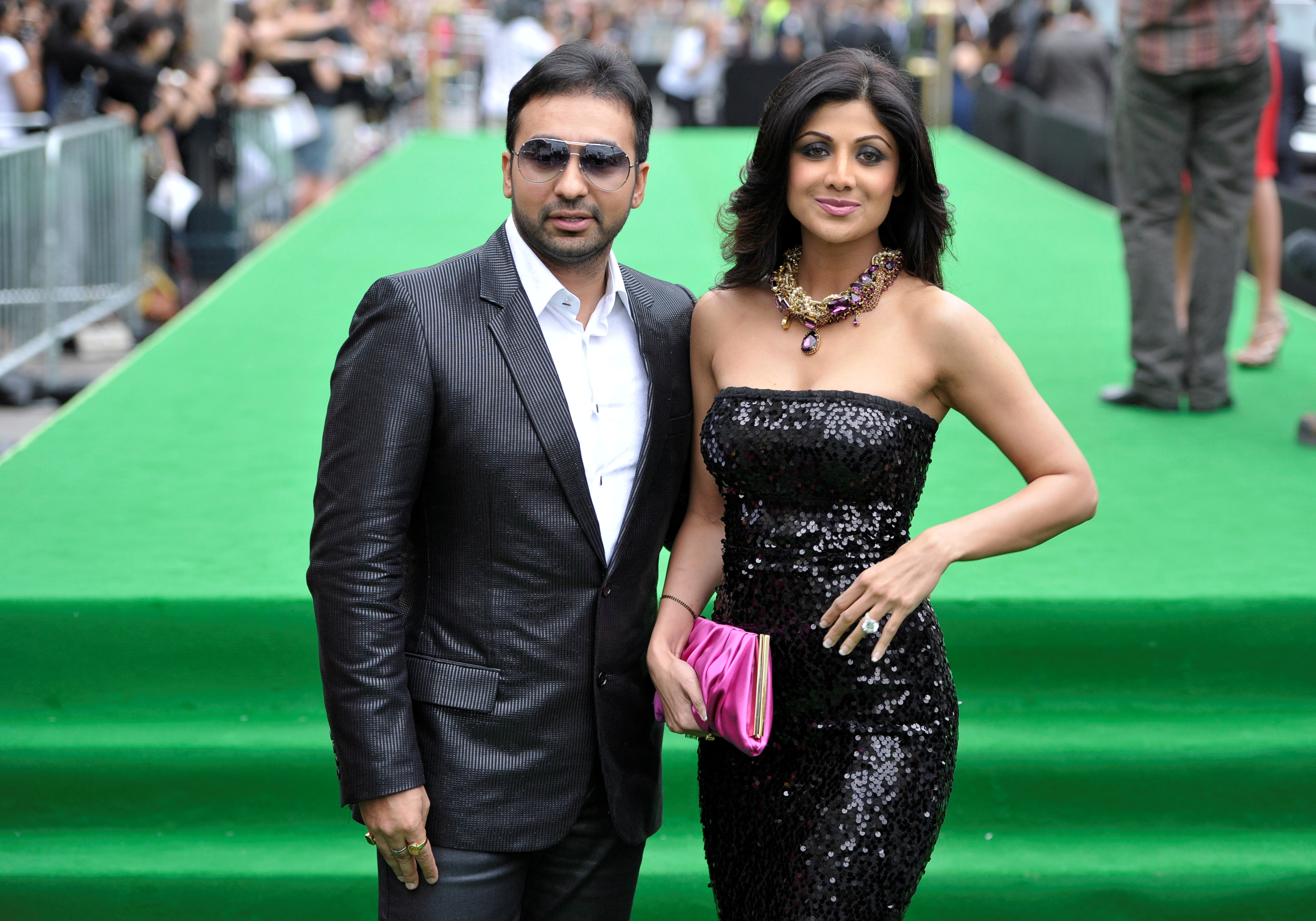 Bollywood actress Shilpa Shetty and husband Raj Kundra (R) arrive on the green carpet during the International Indian Film Academy (IIFA) Awards in Toronto June 25, 2011. REUTERS/Mike Cassese