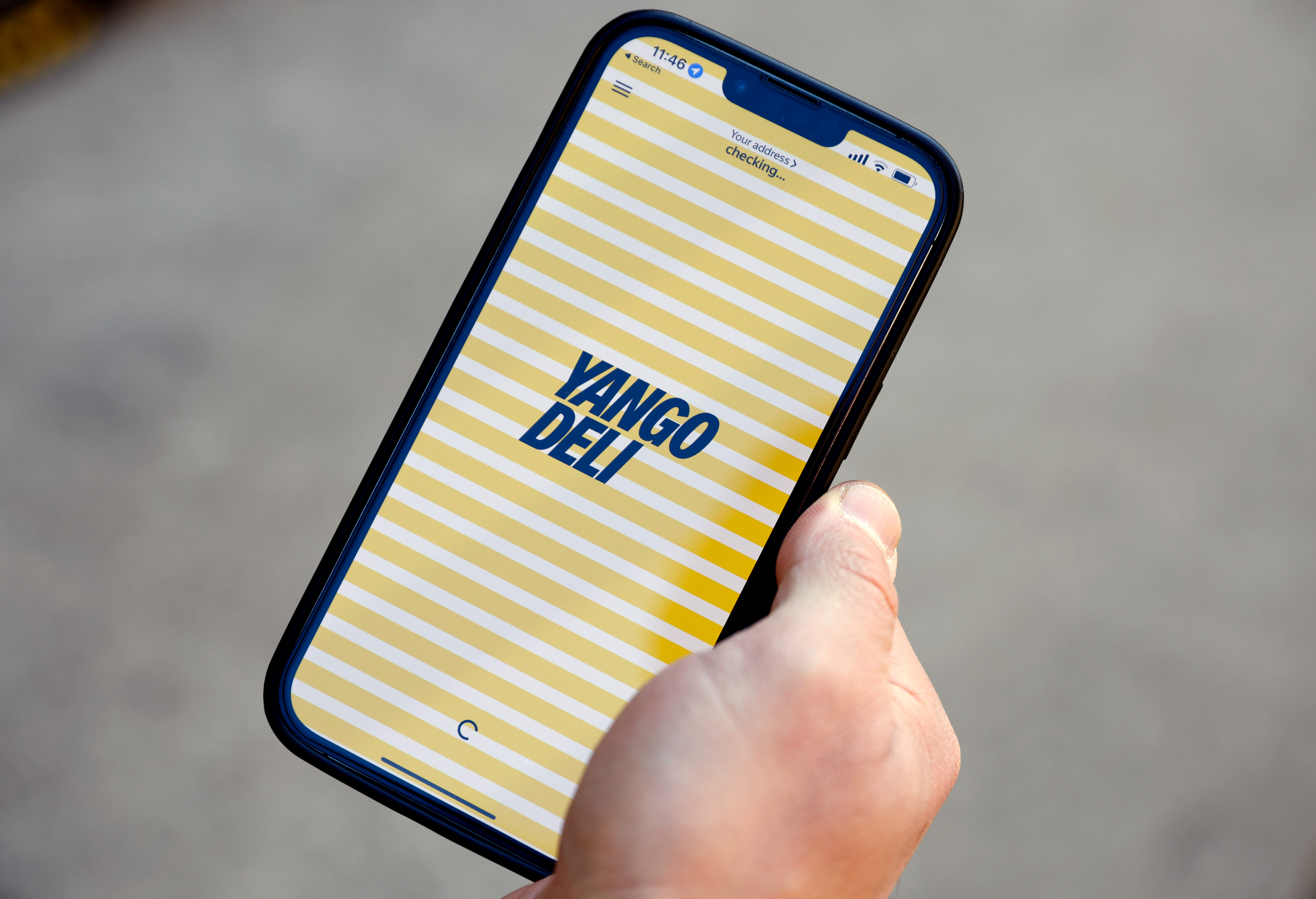 The logo of Yango Deli is seen on a smart phone app prior to the opening of their new store in London, Britain, October 6, 2021. Picture taken October 6, 2021. REUTERS/John Sibley