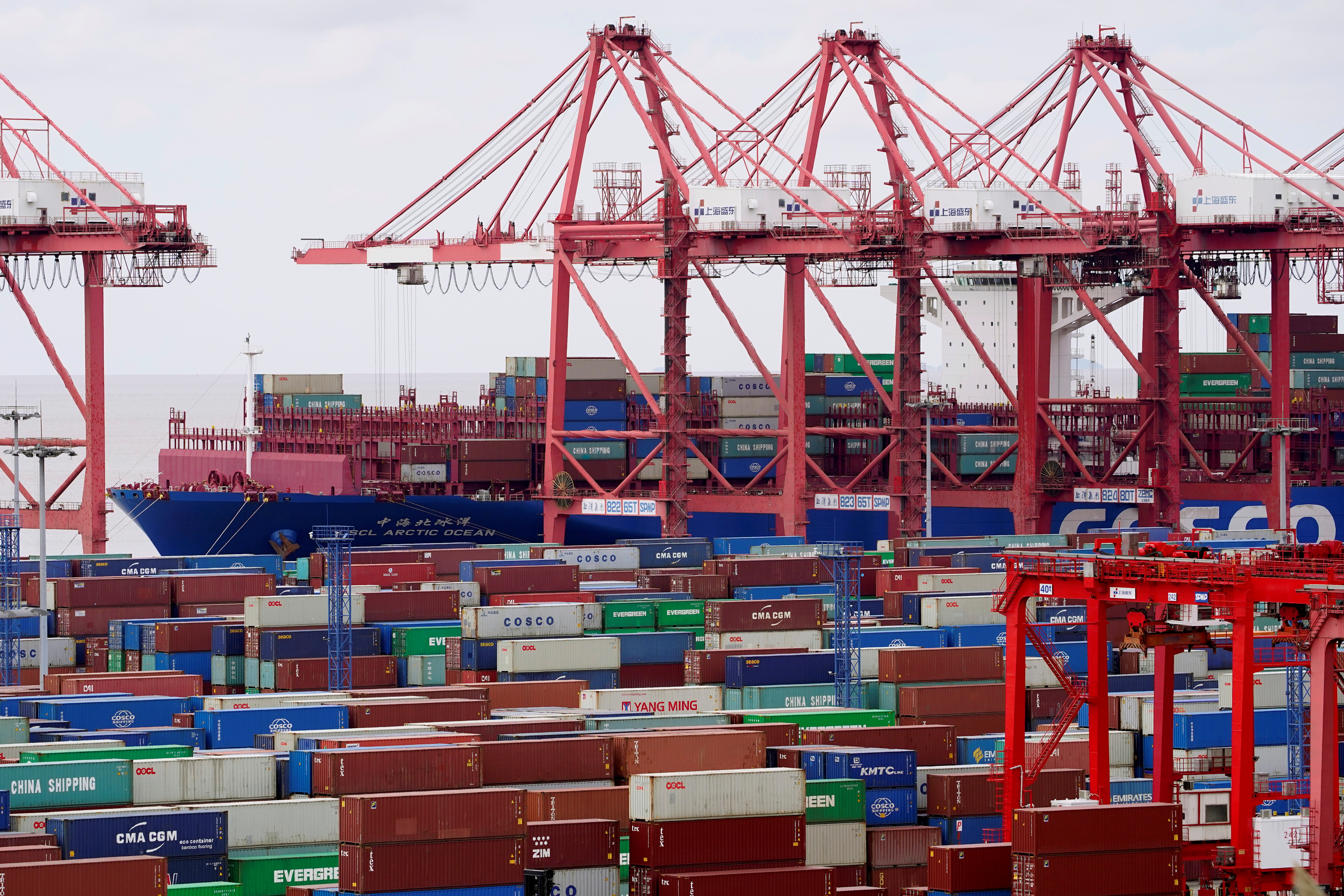 Containers are seen at the Yangshan Deep Water Port in Shanghai, China, as the coronavirus disease (COVID-19) outbreak continues, October 19, 2020. REUTERS/Aly Song/File Photo