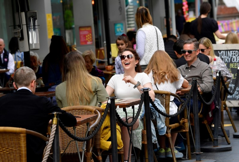 People relax at outdoor dining areas on the South Bank, as lockdown restrictions continue to ease amidst the spread of the coronavirus disease (COVID-19) pandemic, in London, Britain May 28, 2021. REUTERS/Toby Melville/File Photo