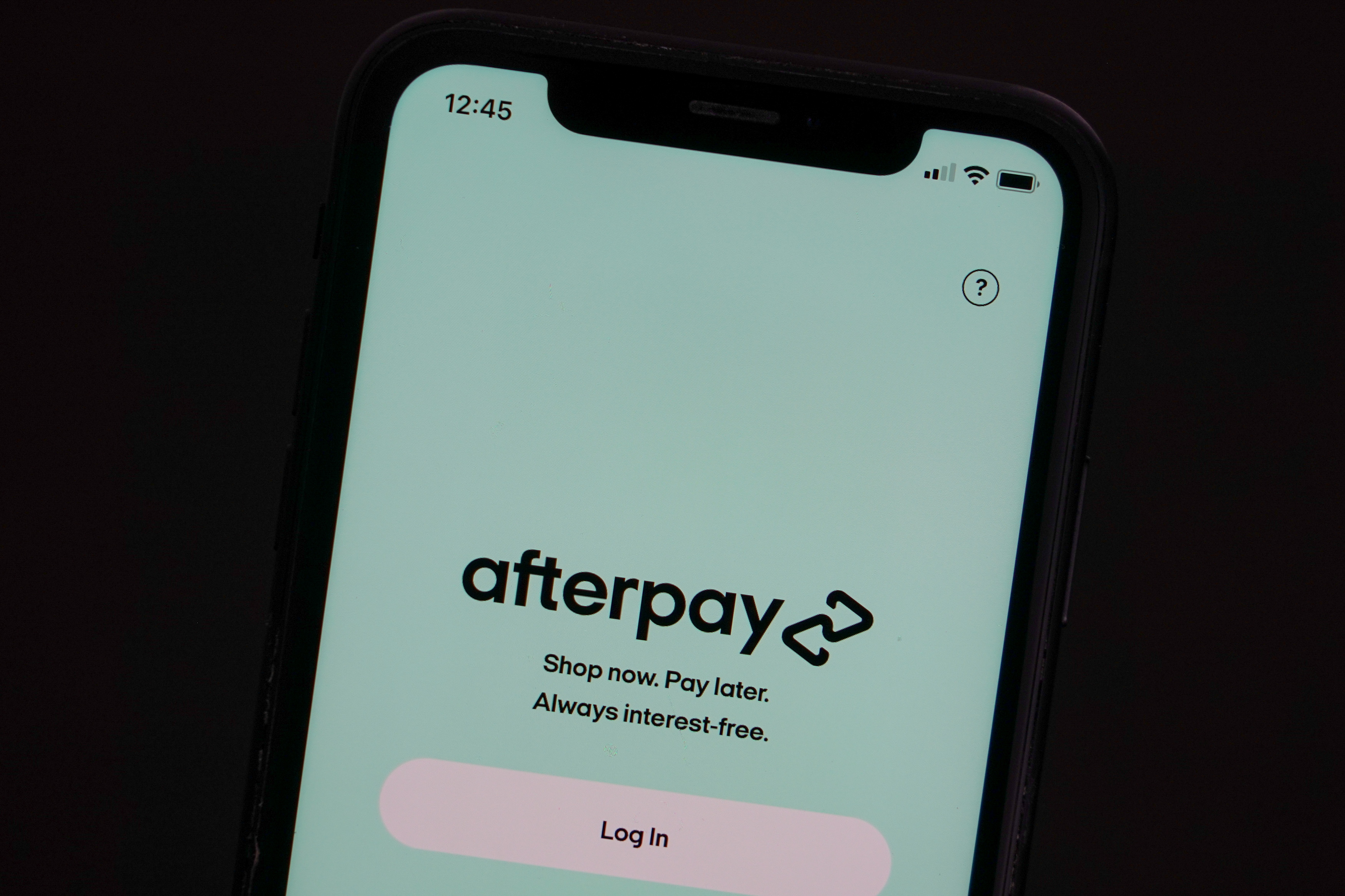 The Afterpay app is seen on the screen of a mobile phone in a picture illustration taken August 2, 2021.  REUTERS/Loren Elliott/Illustration