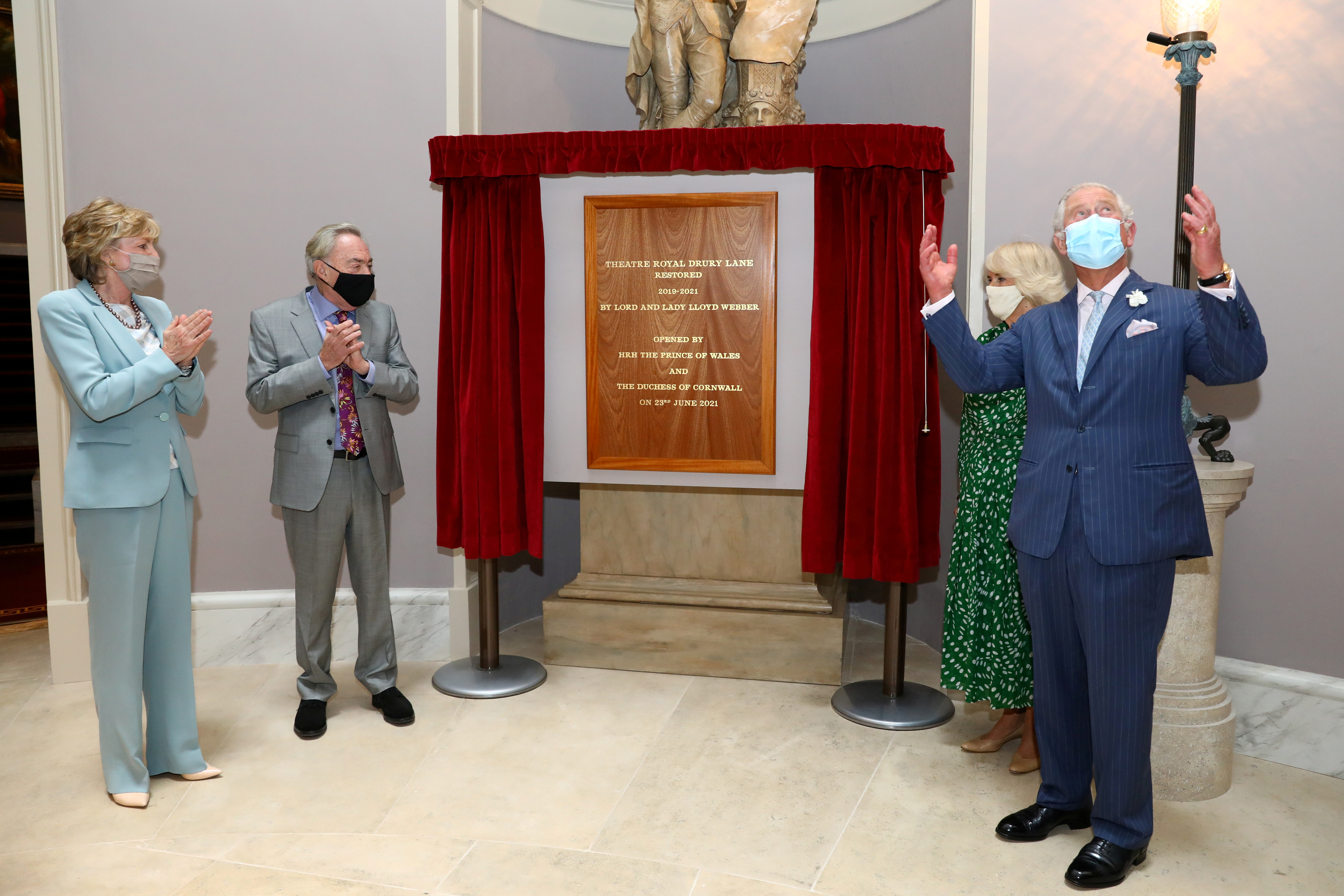 Britain's Prince Charles and Camilla, Duchess of Cornwall, stand next to Lord Andrew Lloyd Webber and Lady Madeleine Lloyd Webber as they unveil a plaque to commemorate their visit to Theatre Royal in London, Britain June 23, 2021. Tim P. Whitby/Pool via REUTERS