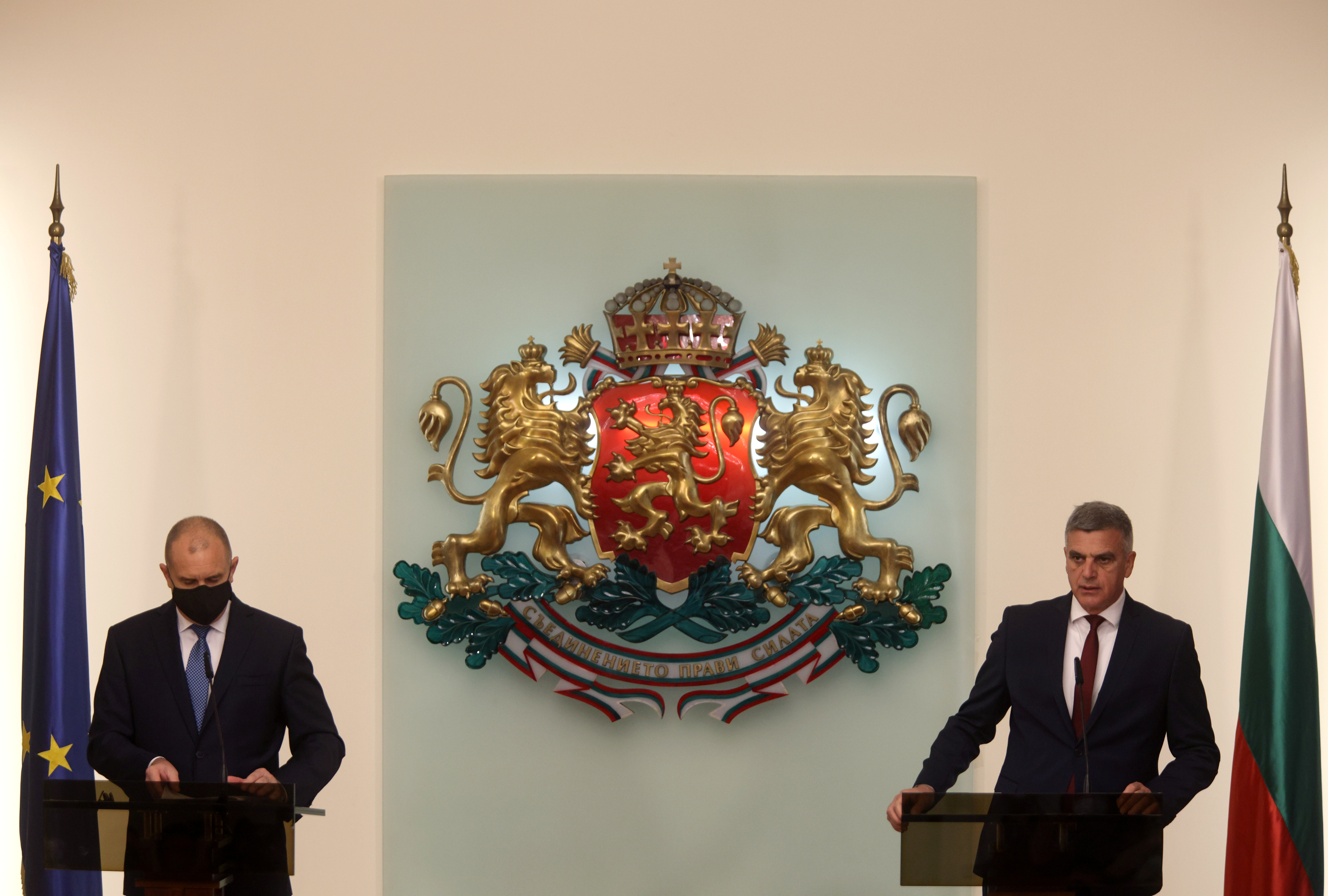 Newly appointed caretaker Prime Minister Stefan Yanev speaks next to Bulgaria's President Rumen Radev during an official ceremony in Sofia, Bulgaria, May 12, 2021. REUTERS/Stoyan Nenov