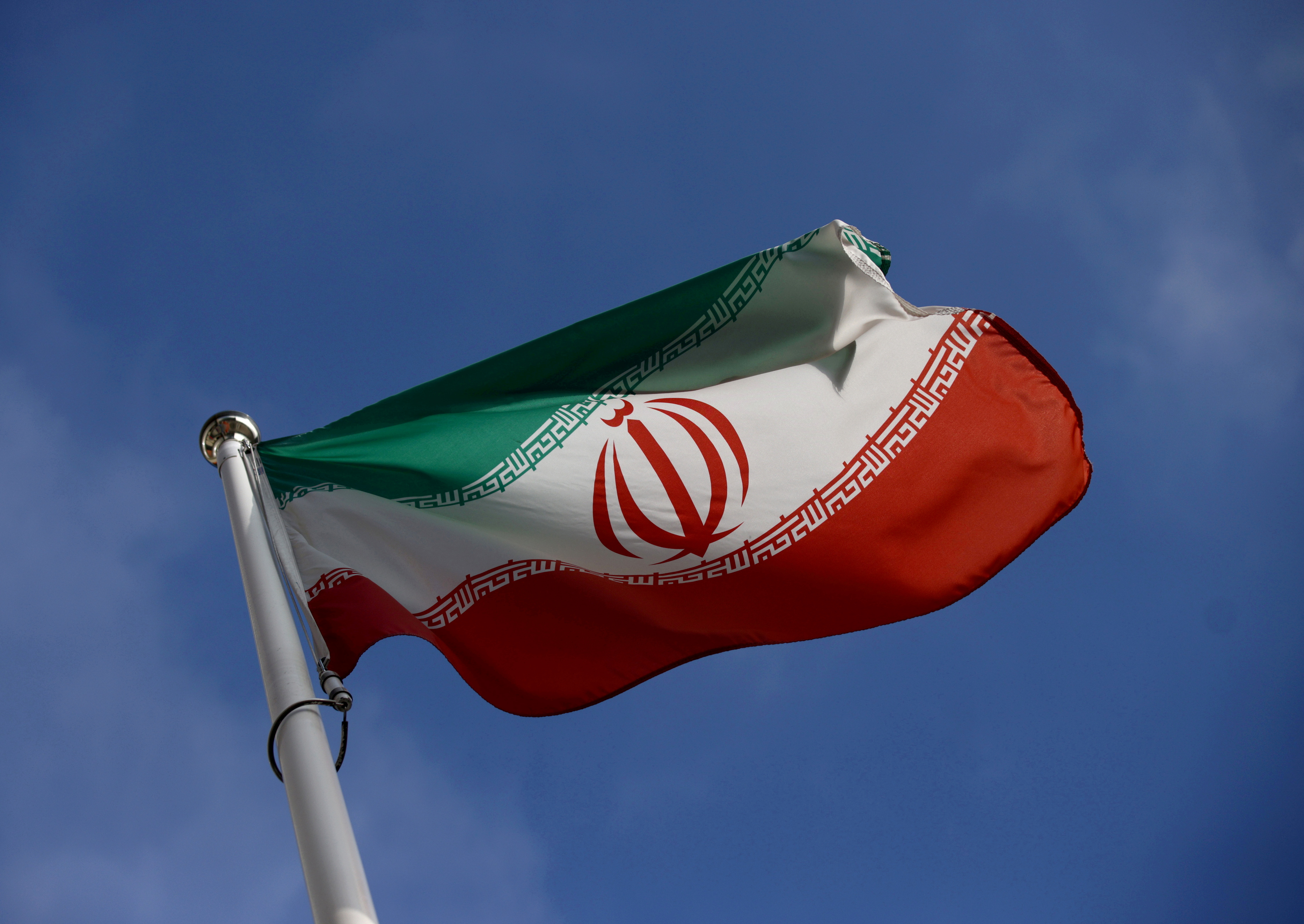 The Iranian flag waves in front of the International Atomic Energy Agency (IAEA) headquarters, before the beginning of a board of governors meeting, in Vienna, Austria, March 1, 2021. REUTERS/Lisi Niesner
