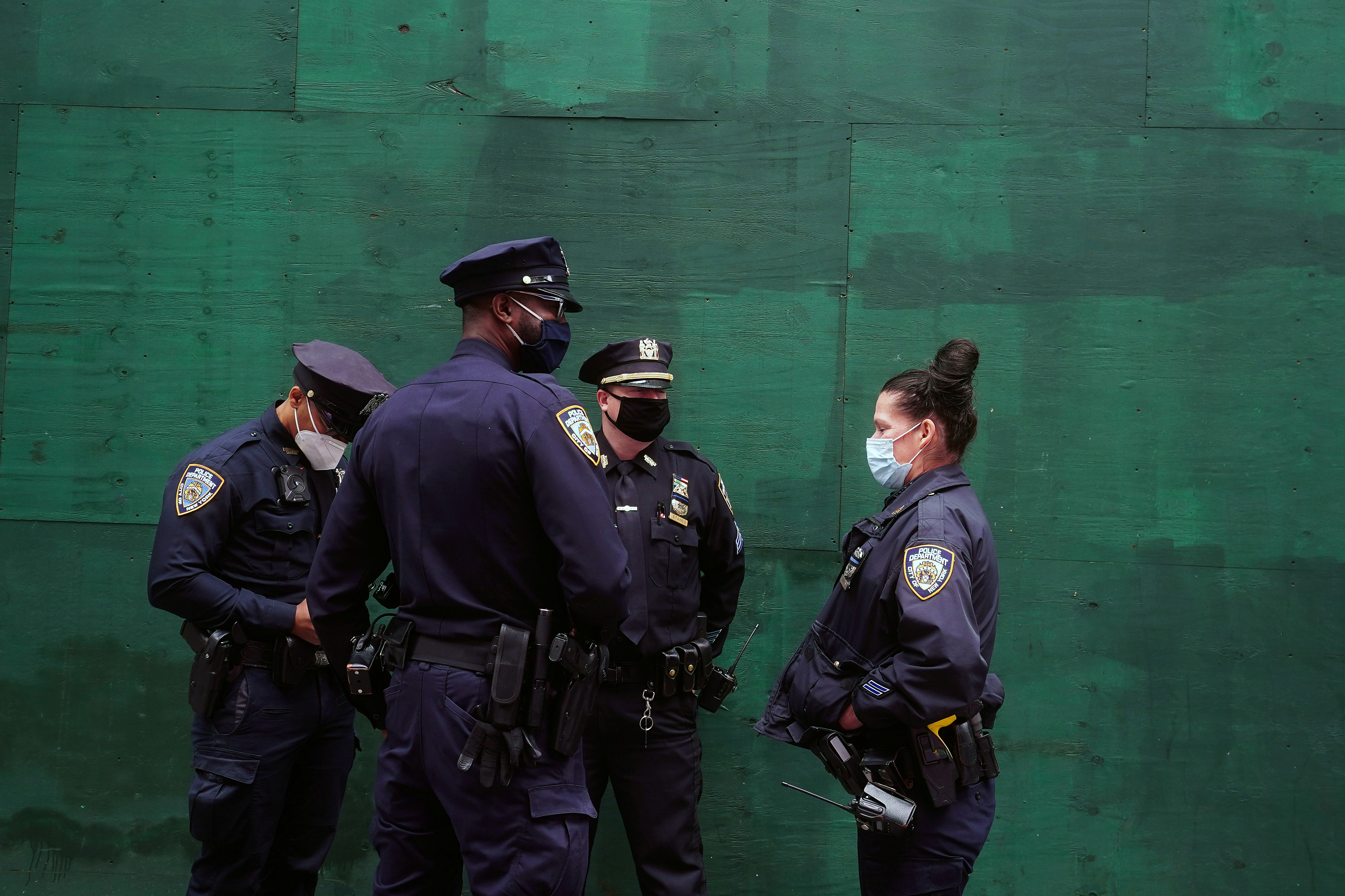 Police officers stand in Times Square in the Manhattan borough of New York City, New York, U.S., May 10, 2021.  REUTERS/Carlo Allegri/File Photo