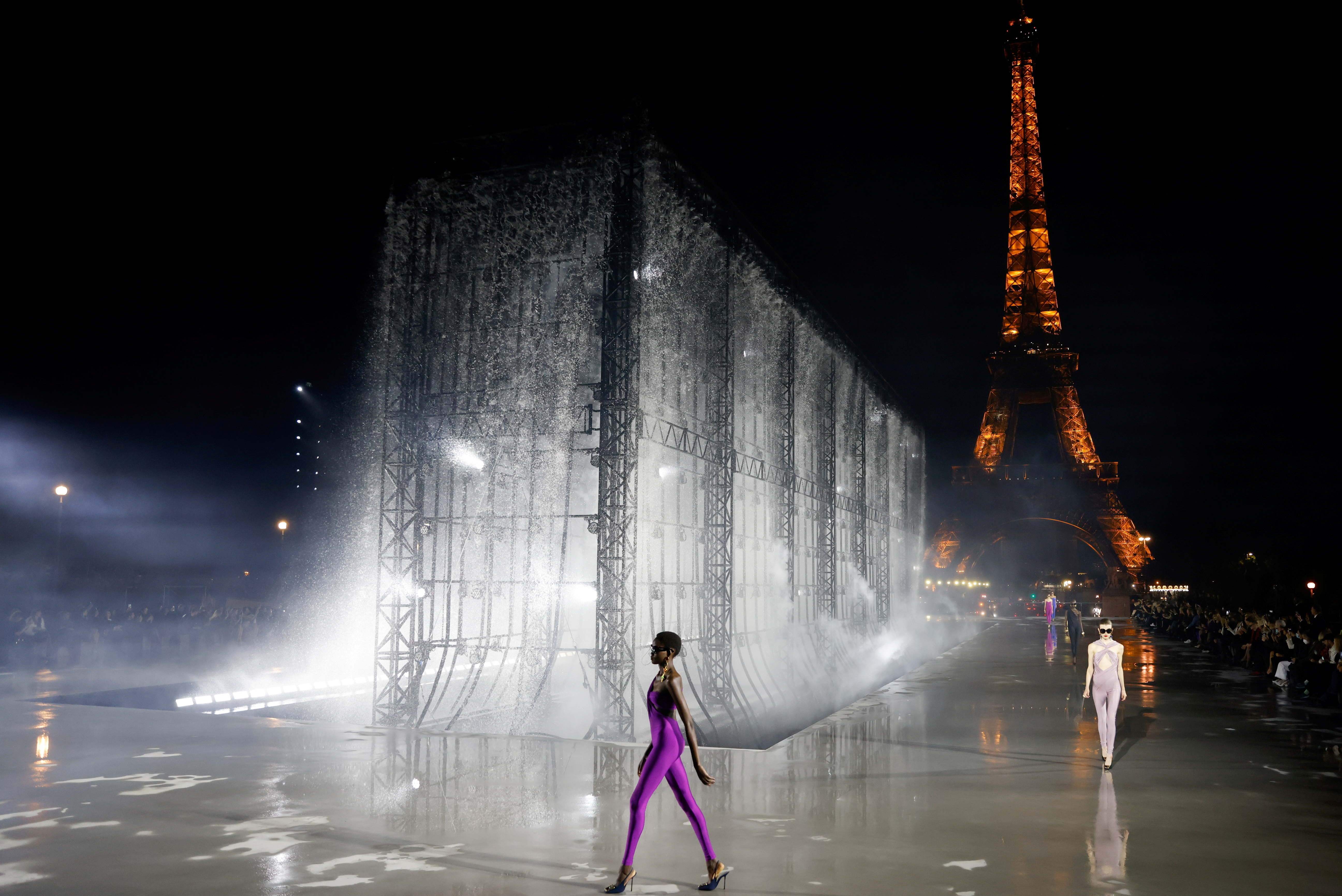 A model presents a creation by designer Anthony Vaccarello as part of his Spring/Summer 2022 women's ready-to-wear collection show for fashion house Saint Laurent, in front of the Eiffel Tower during Paris Fashion Week, in Paris, France, September 28, 2021. REUTERS/Stephane Mahe