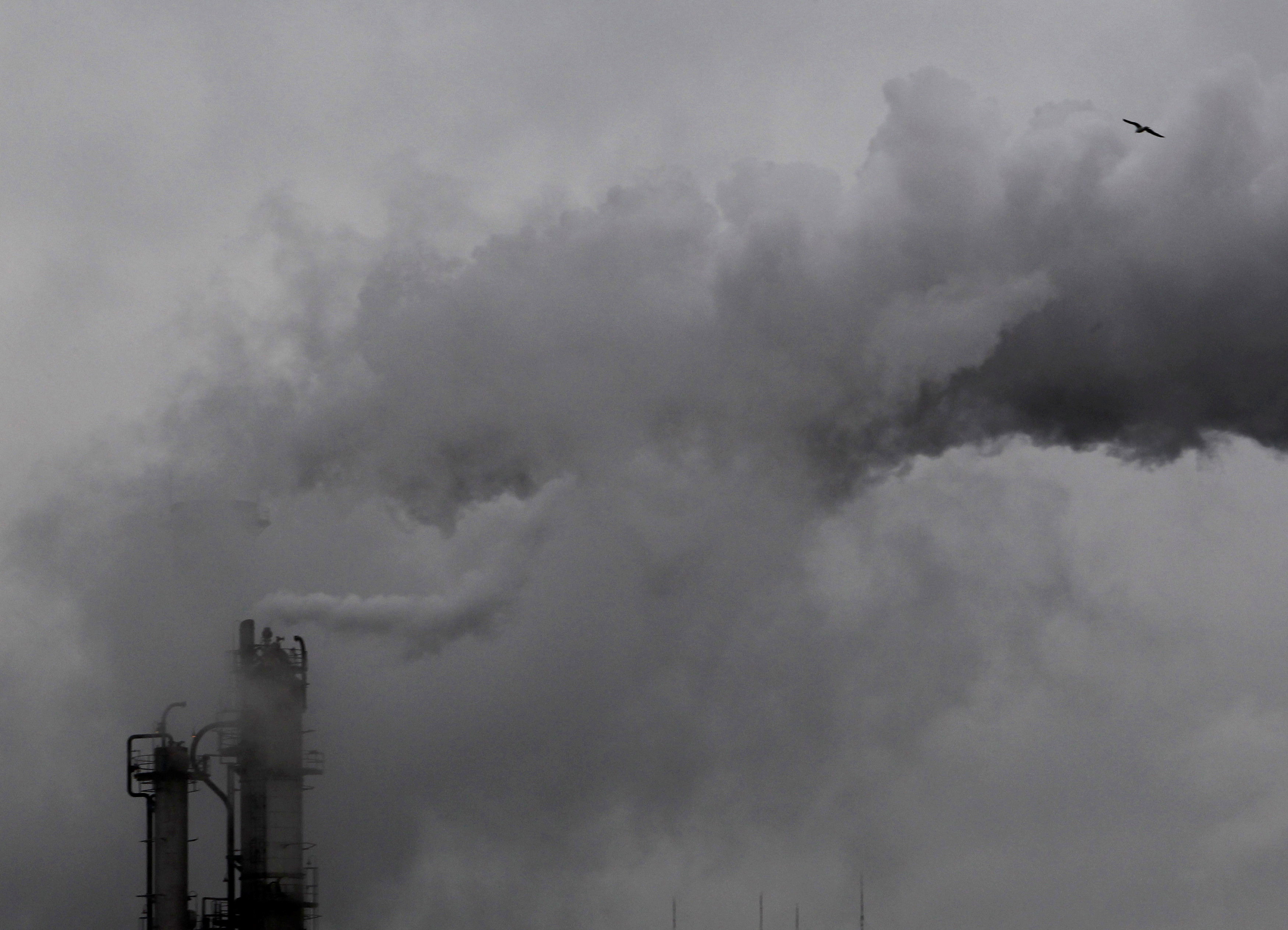 Smoke billows from chimneys at an industrial district near Tokyo February 28, 2011. REUTERS/Kim Kyung-Hoon/File Photo